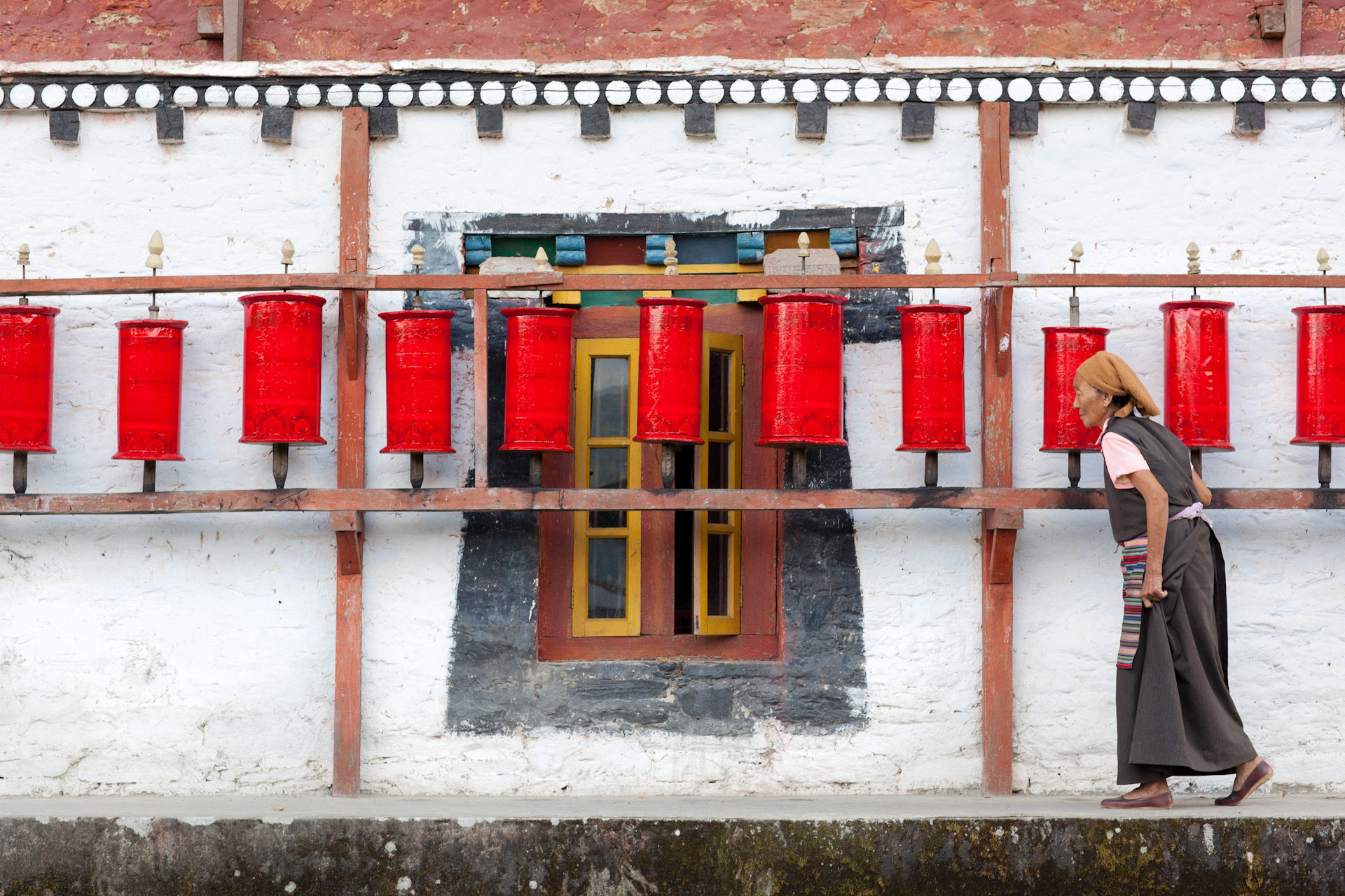 India-Sikkim-Travel-Tashiding-Monastery-Prayer-Wheels-Woman-Jason-Bax.JPG