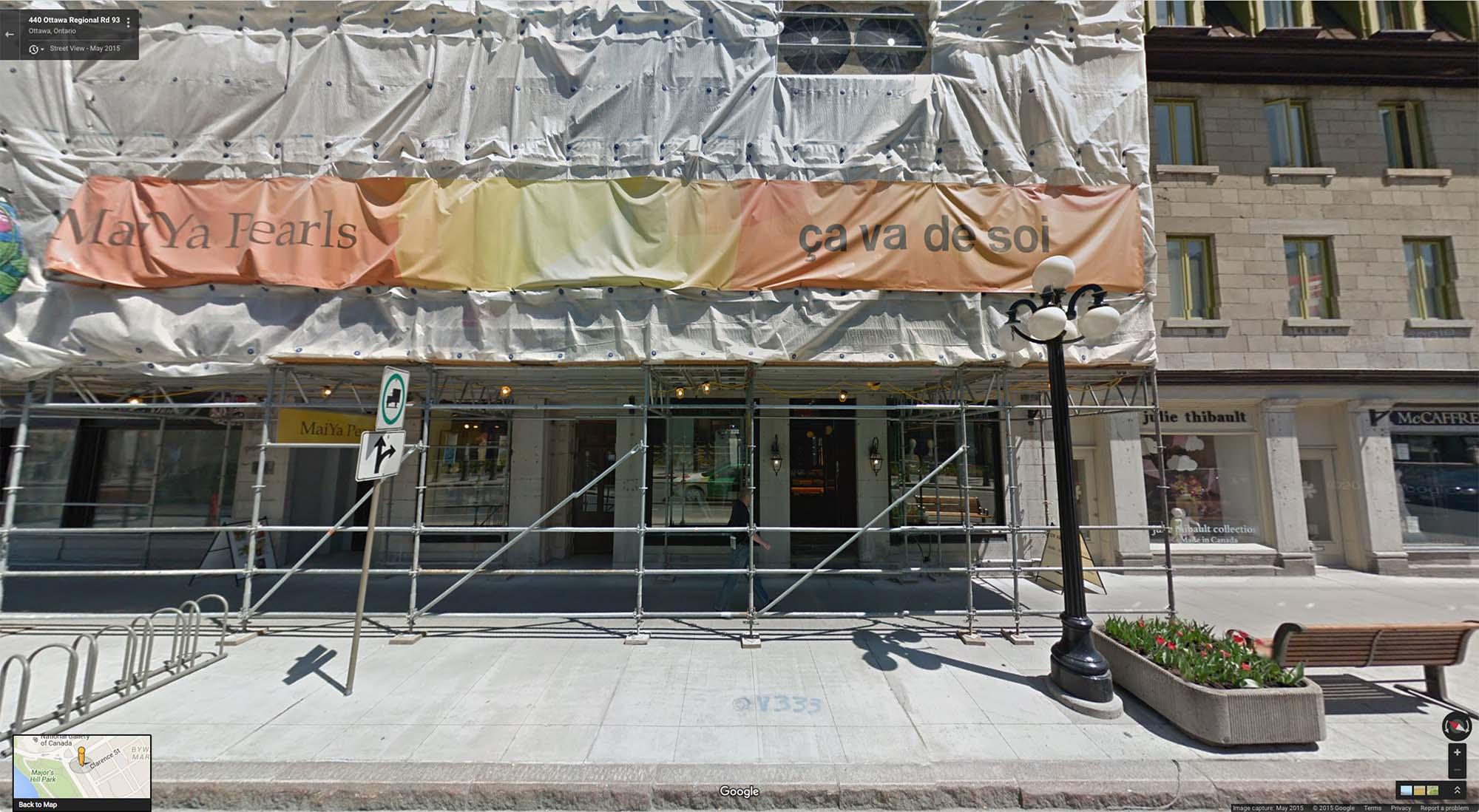 Origin Studios' front door hidden behind scaffolding in the summer of 2015. (Google Street View)