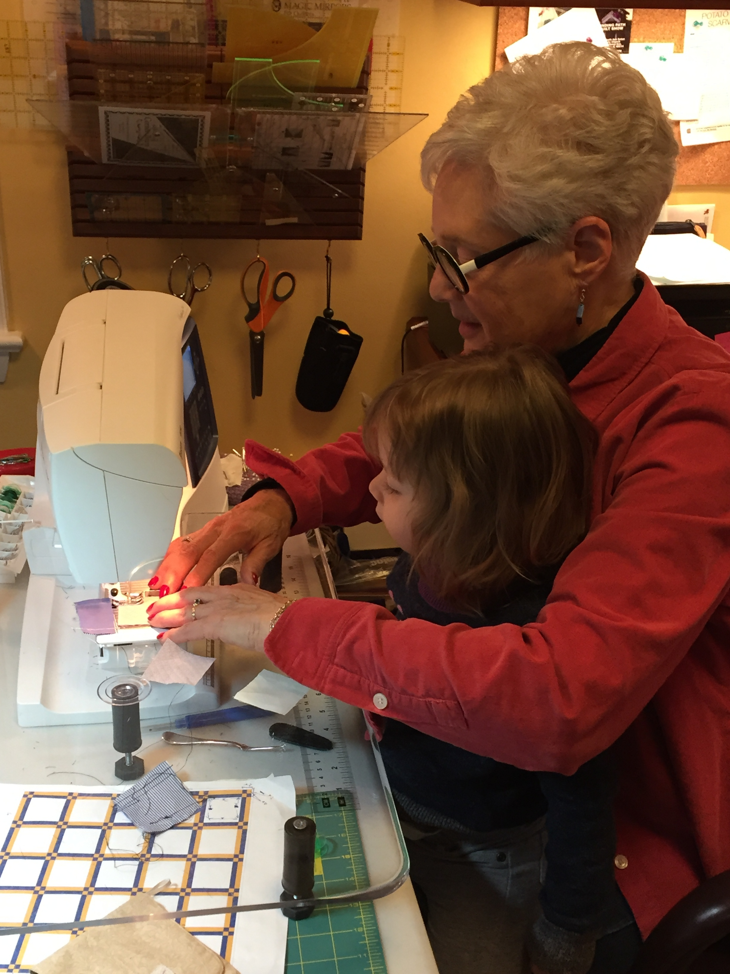 "Linda sewing with her 2 1/2 year old. In Linda's words, ""This is what it's for!"""