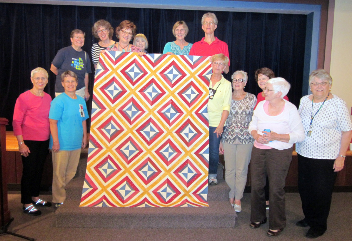 The quilt of valor top with the group who stayed to the end, minus those taking pictures!