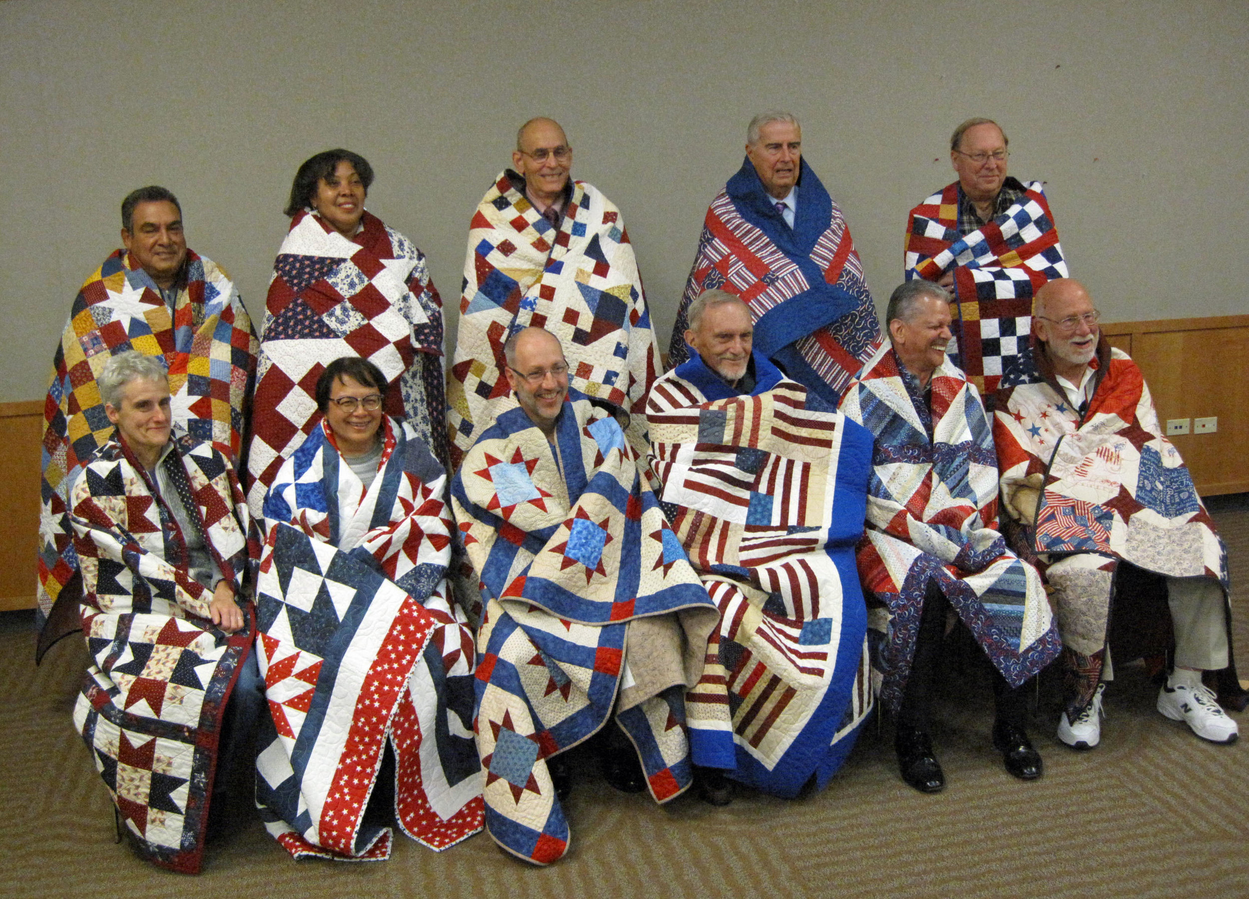 Eleven of the 12 veterans in Lake Zurich who were awarded quilts in 10/23, made by VQ guild members.