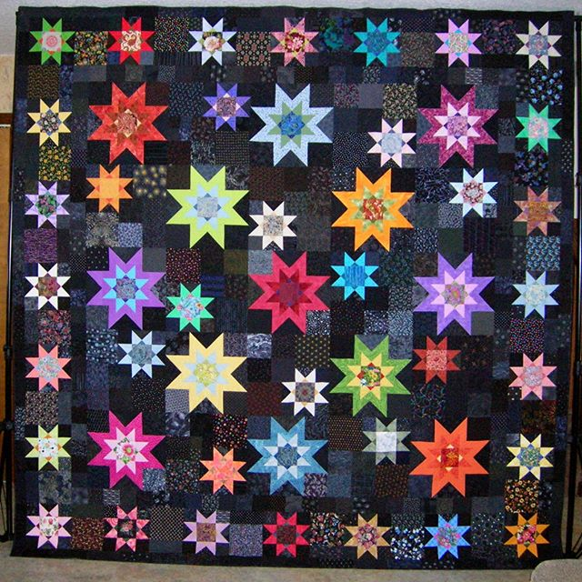"""See """"Midnight Stars"""" by Emmy Moore at our show this weekend. Quilts from the Village will be held October 4-5, 2019, in Libertyville, Illinois. #VQshow2019 #QuiltsfromtheVillage #quilting #quilt #sewing #quiltshow #VillageQuilters #VillageQuiltersLBLF"""
