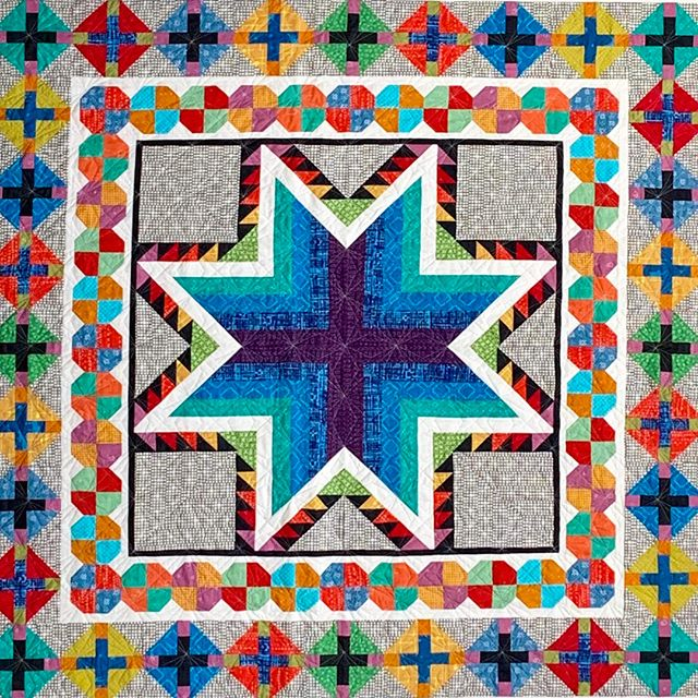 """See the beautiful center medallion of """"Outward Bound"""" by @celstrat at our show October 4-5, 2019, in Libertyville, Illinois.  #VQshow2019 #QuiltsfromtheVillage #quilting #quilt #sewing #quiltshow #VillageQuilters #VillageQuiltersLBLF"""