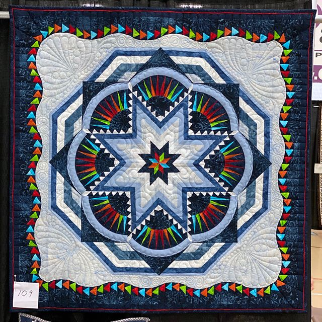 Check out this smaller interpretation of our raffle quilt in the silent auction.  The winner of the auction will be announced on Saturday (October 5, 2019) at Quilts from the Village in Libertyville, Illinois.  #VQshow2019 #QuiltsfromtheVillage #quilting #quilt #sewing #quiltshow #VillageQuilters #VillageQuiltersLBLF