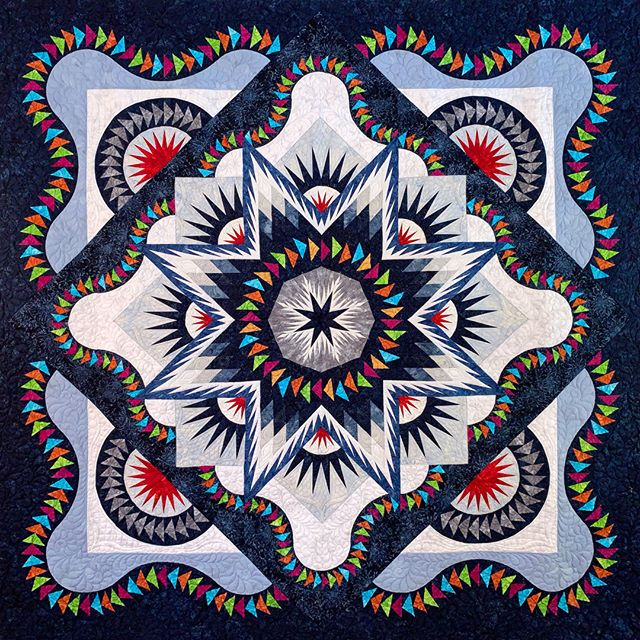 """Last chance to buy your tickets for a chance to win """"Village Glacier Star"""", our stunning raffle quilt!  The winner will be announced on today (Saturday, October 5, 2019) at Quilts from the Village in Libertyville, Illinois.  #VQshow2019 #QuiltsfromtheVillage #quilting #quilt #sewing #quiltshow #VillageQuilters #VillageQuiltersLBLF #rafflequilt"""