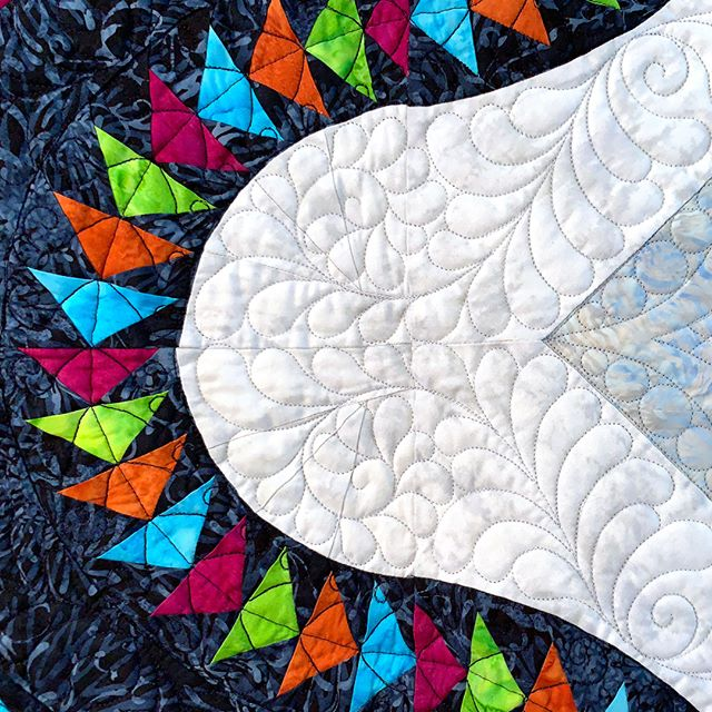 """The exquisite quilting on our raffle quilt """"Village Glacier Star"""" is a perfect complement to the the detailed piecing. Today is the last day to buy your ticket; the drawing will be held this afternoon (Saturday, October 5, 2019) at the Libertyville Sports Complex.  #VQshow2019 #QuiltsfromtheVillage #quilting #quilt #sewing #quiltshow #VillageQuilters #VillageQuiltersLBLF #rafflequilt"""