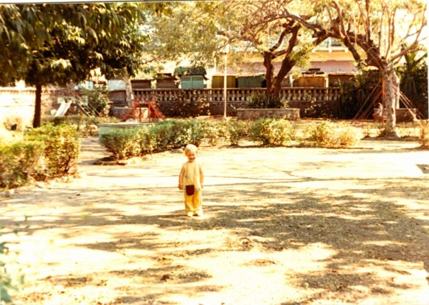 18 months old, fashionable in yellow with Indian Purse, Making my Playground Debut. Poona, INDIA 1980