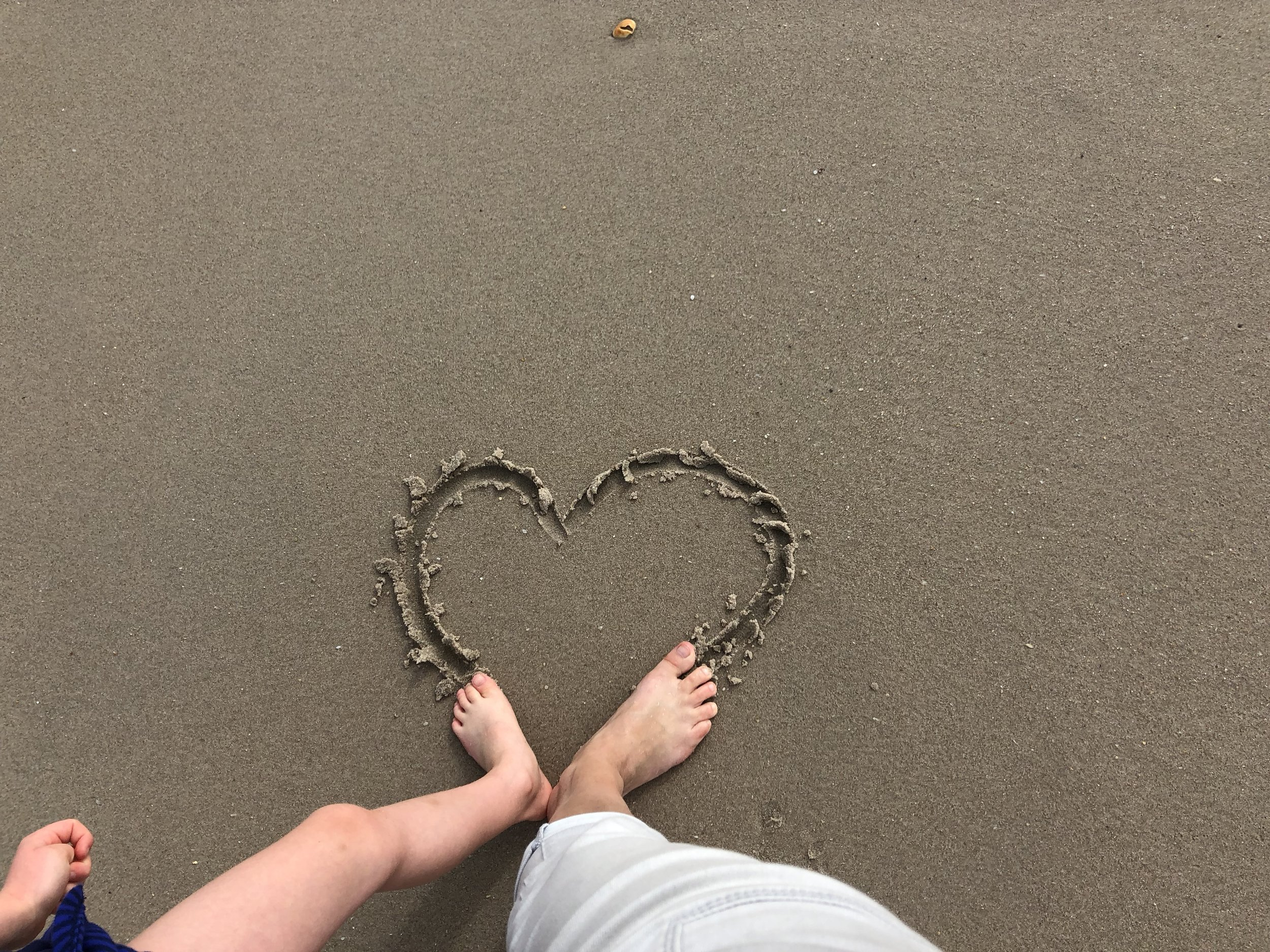 Juni-Mom heart in sand.jpg