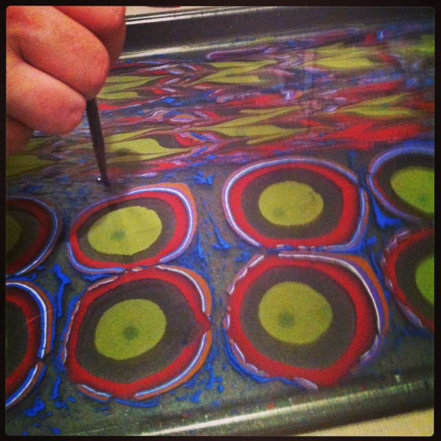 Combing Gel-Git into the paint floating on the size.