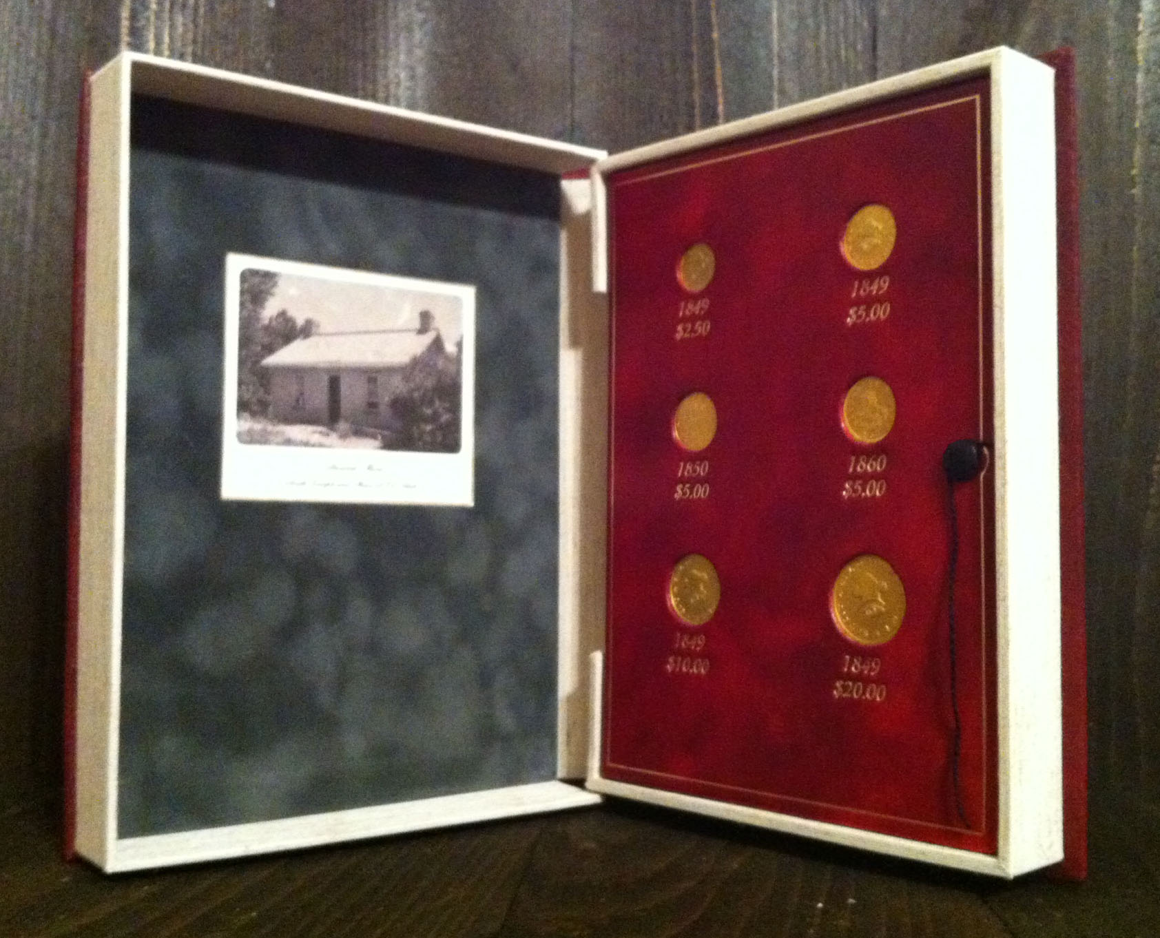 Inside cover of the presentation clamshell for the Mormon gold pieces.