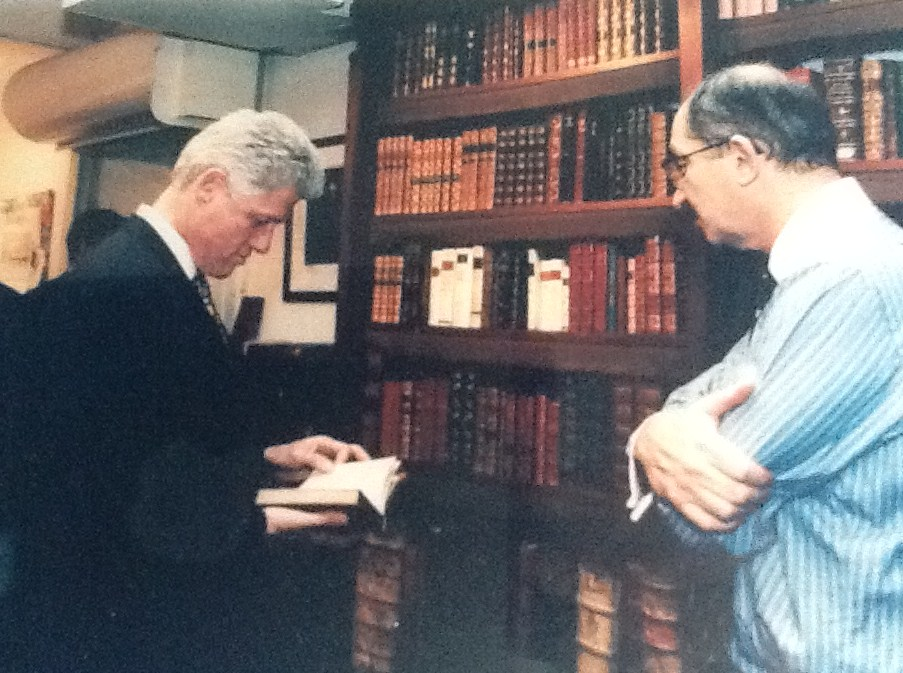 Peter with President Clinton, while President Clinton visited Peter's store.