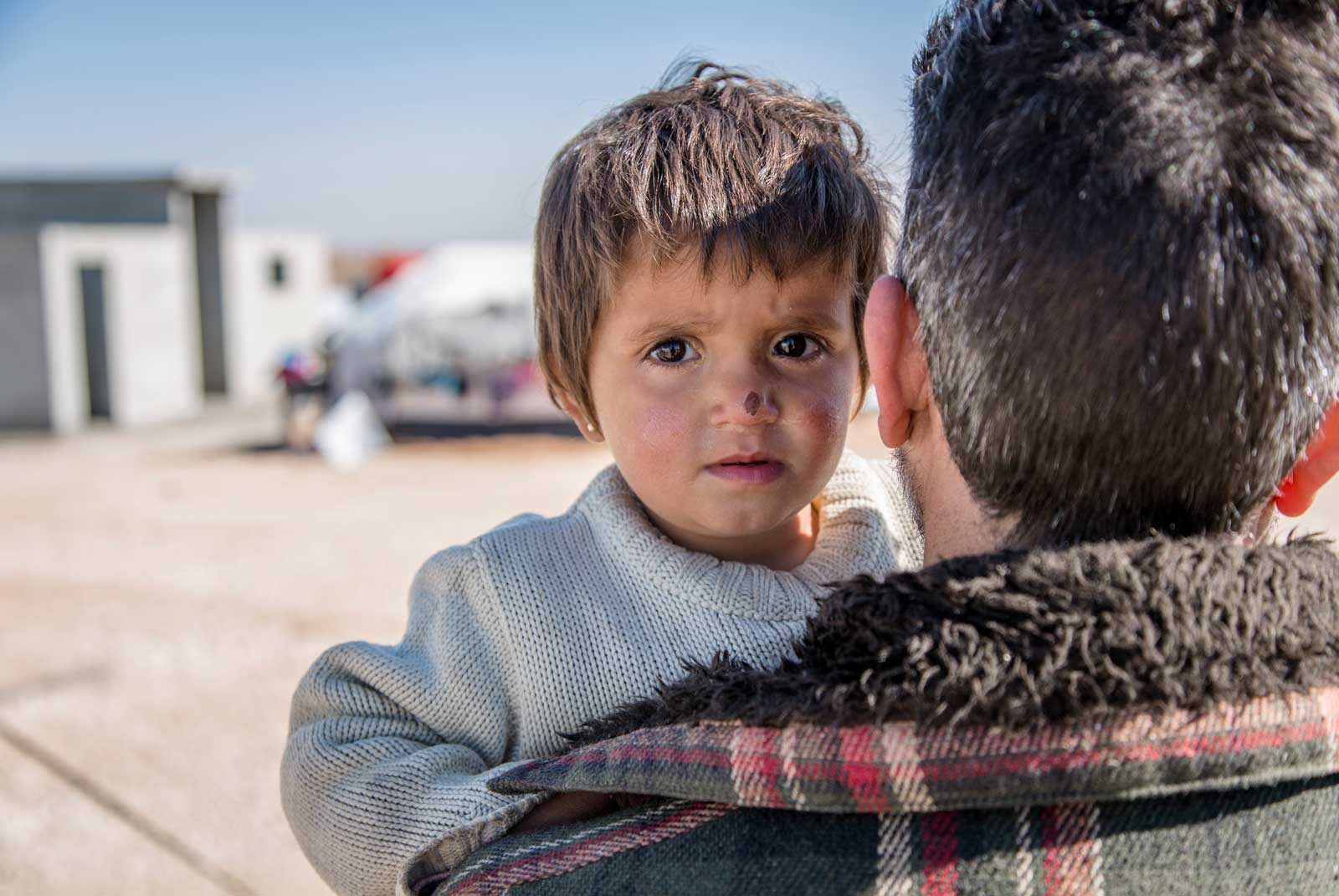 HISHAM*, A SCHOOL TEACHER FROM DEIR EZZOUR IN SYRIA, ARRIVED IN AL HOL CAMP WITH HIS WIFE AND FIVE CHILDREN IN FEBRUARY 2017. HISHAM SAYS HIS CHILDREN HAVE WITNESSED VIOLENCE ONE WOULDN'T EVEN SEE IN A FILM. HE WORRIES THAT THE LACK OF SCHOOLING WILL HAVE A DISASTROUS EFFECT ON YOUNGER GENERATIONS. IMAGE BY SAVE THE CHILDREN.