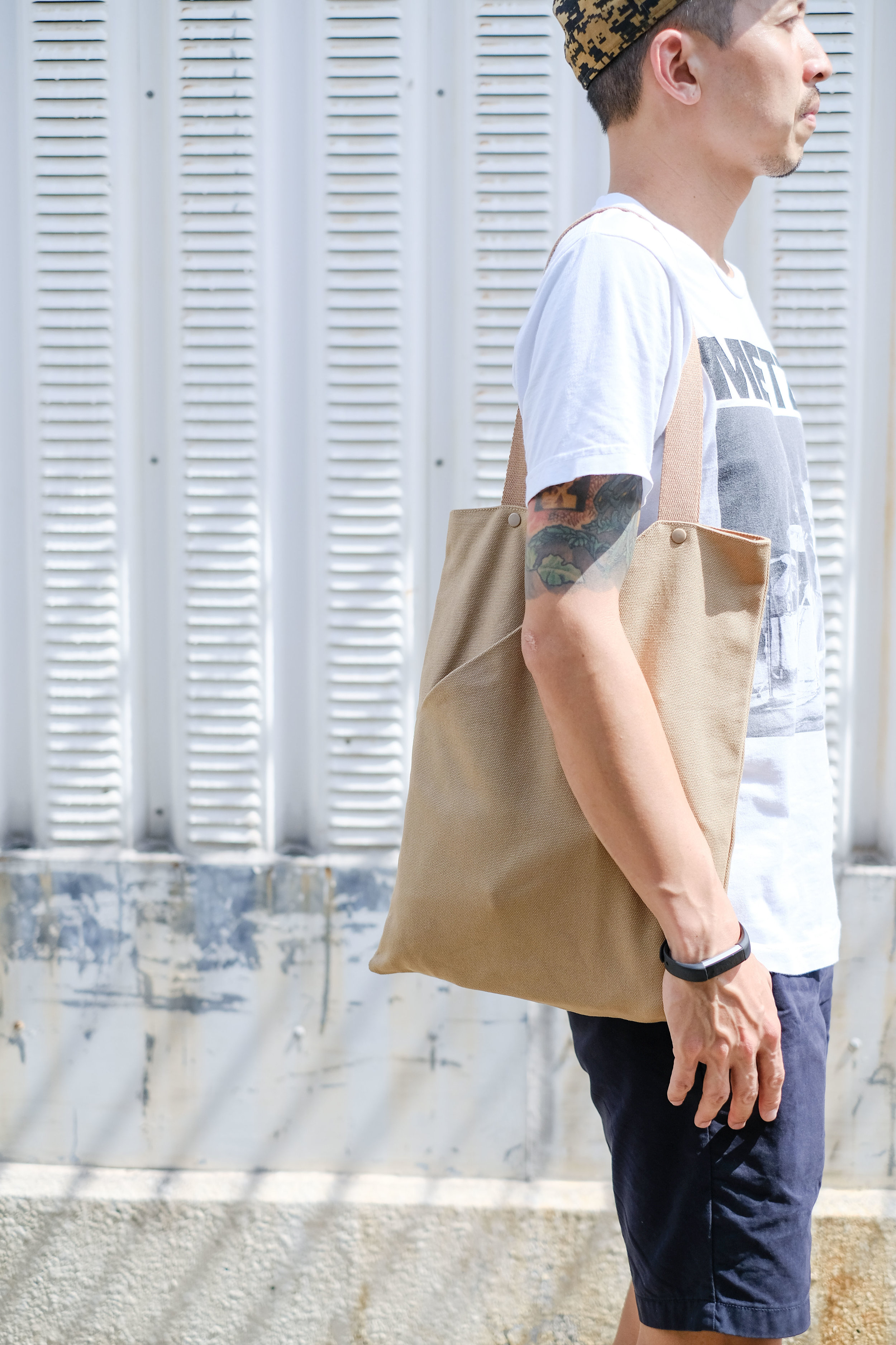Ben wears NOTCH Tote Bag in Haystack, available  here