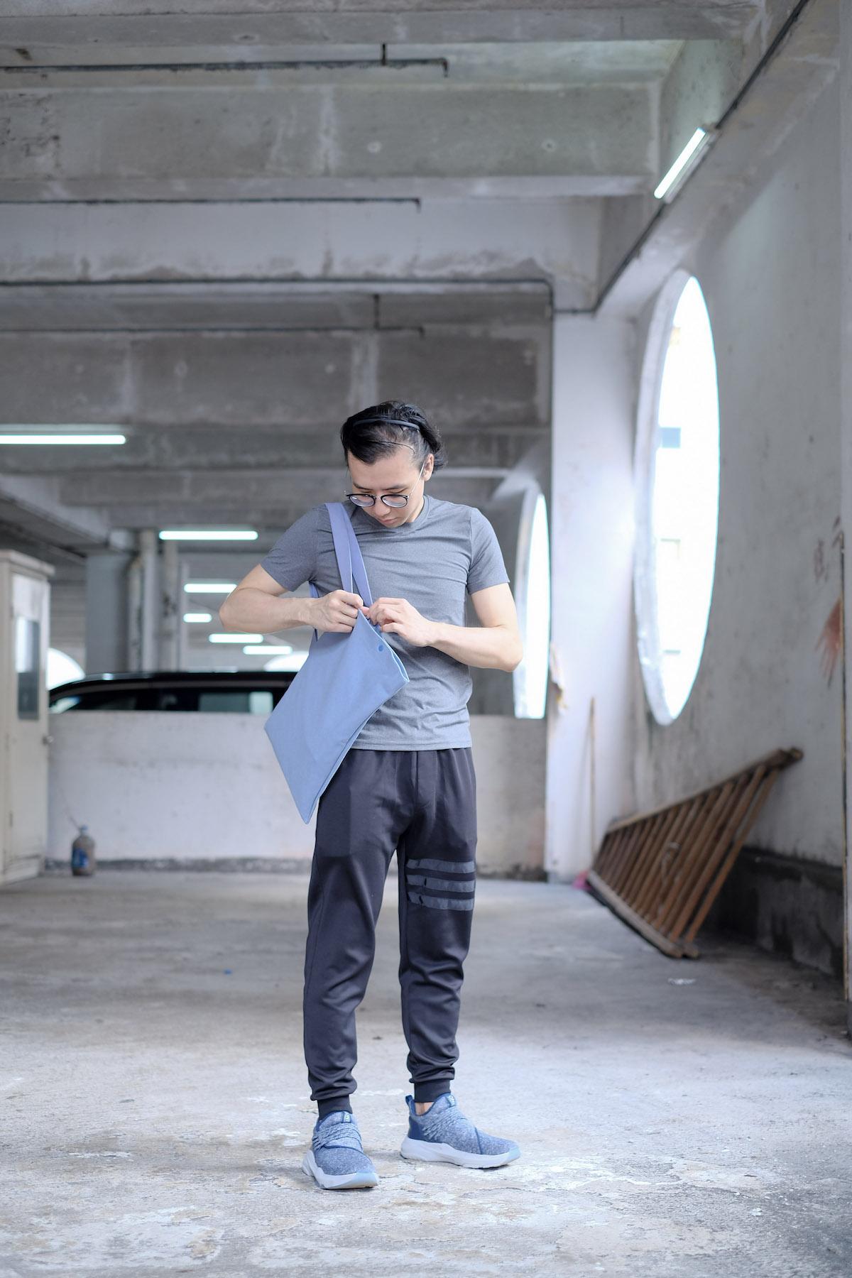 Sim Chan wears  DIAGONAL bag in Dusty Blue
