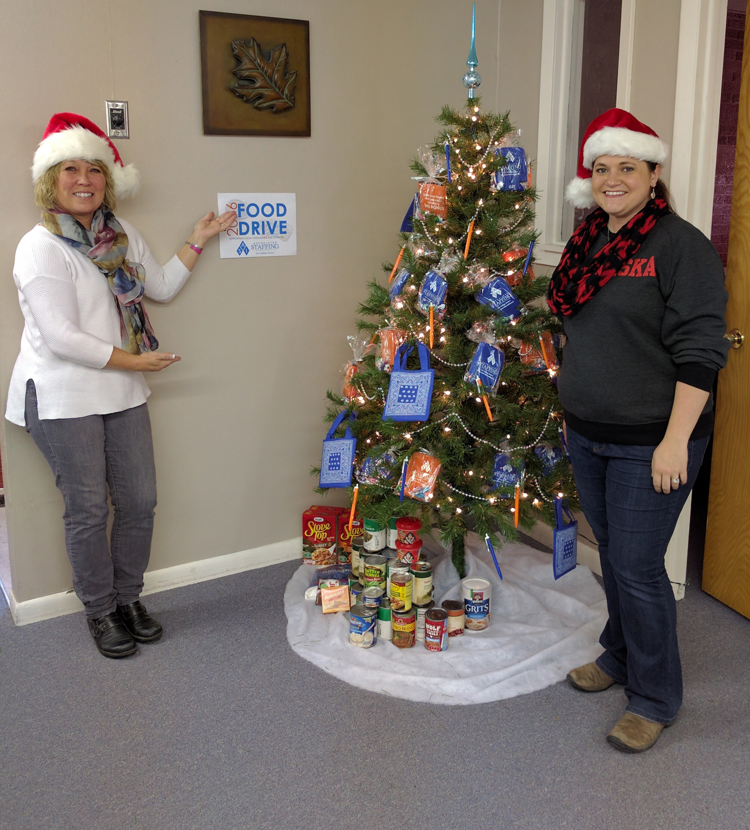 Kearney Branch Manager Kim and Kearney Recruiter Shonda with the start of their Food Drive donations.
