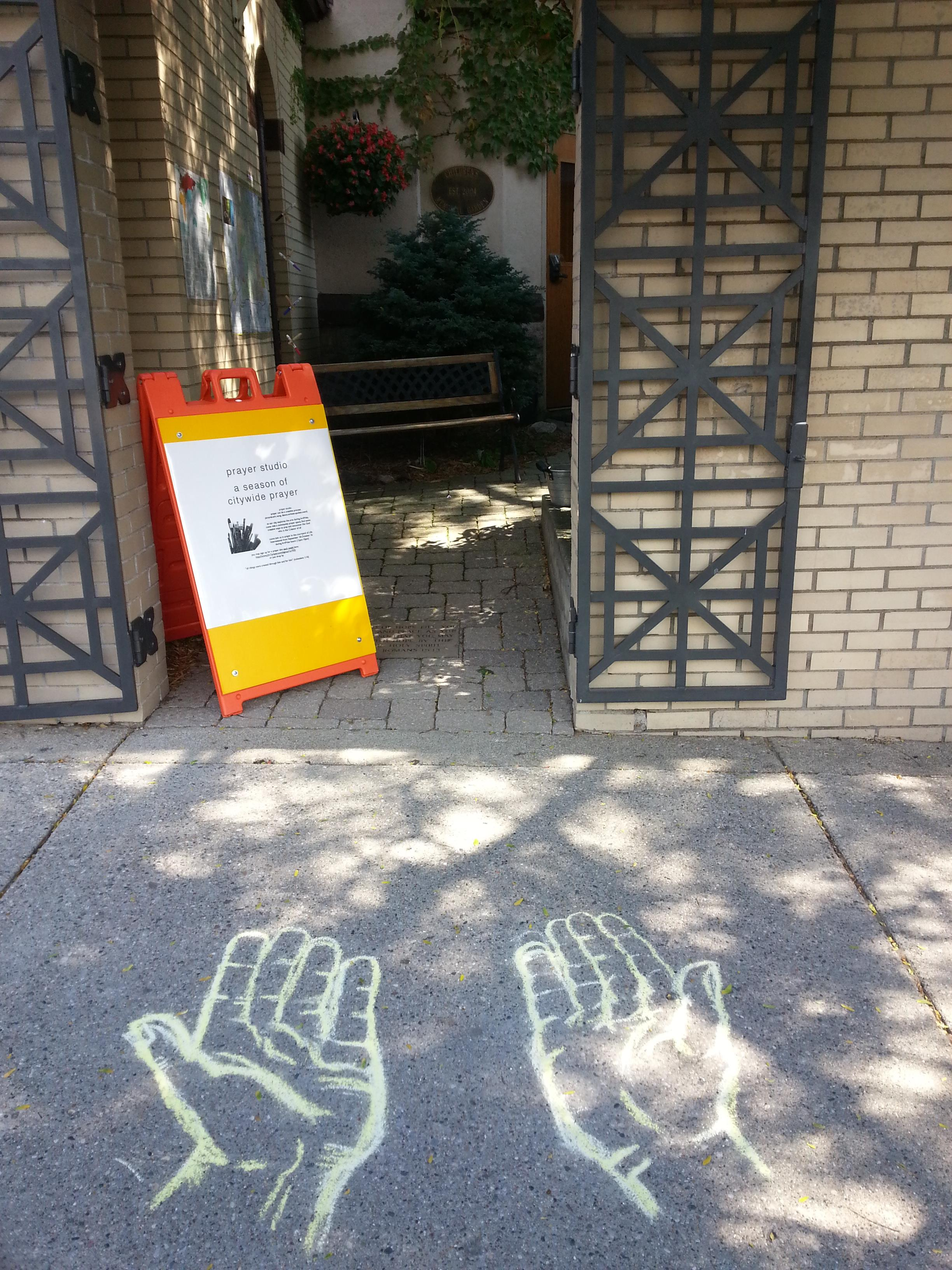 The open, praying hands welcome passersby into the downtown prayer studio.