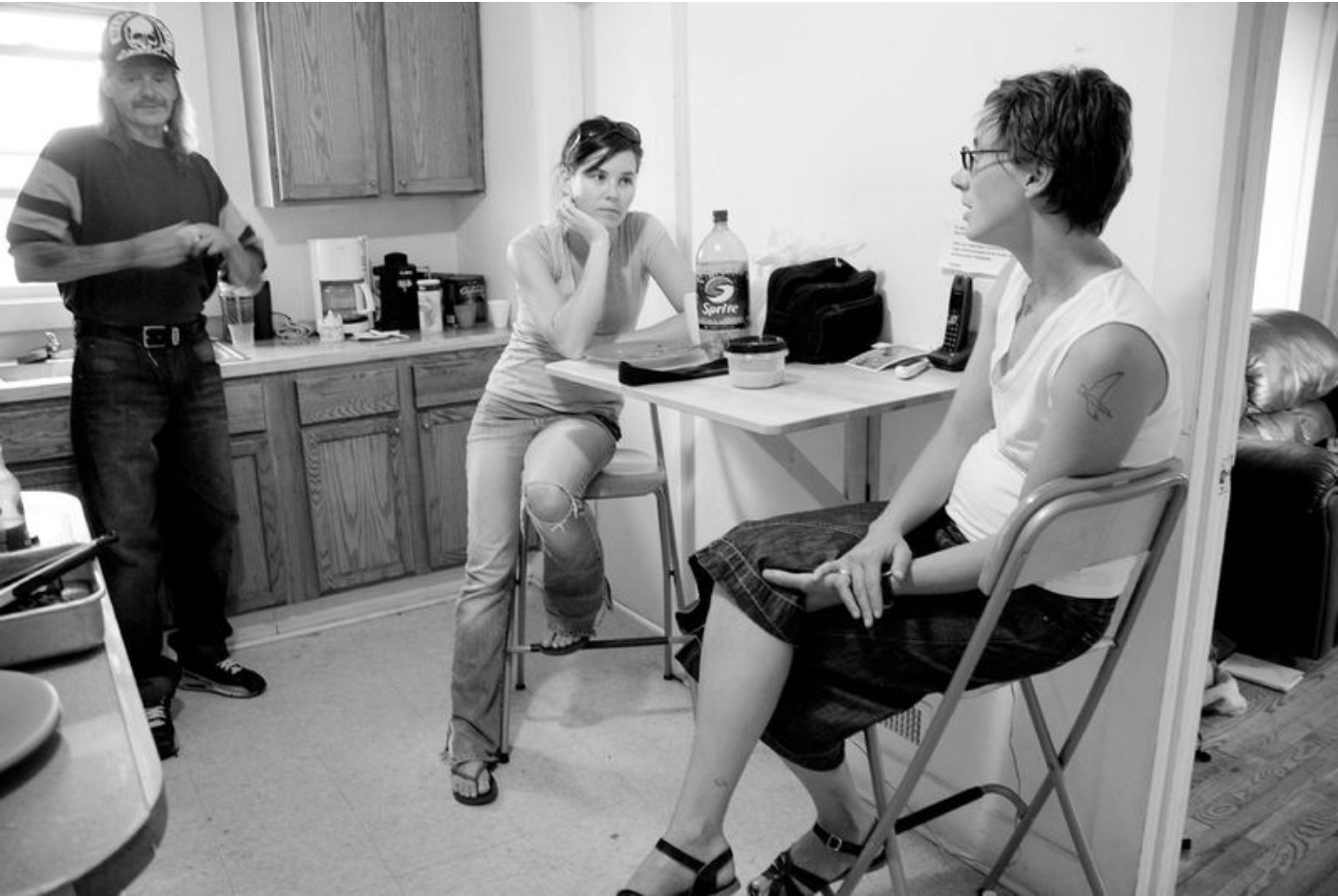 2008: A snapshot of daily life within the Boiler Room house with Jen discipling Sarah amongst the neighbors they had invited to live with them.