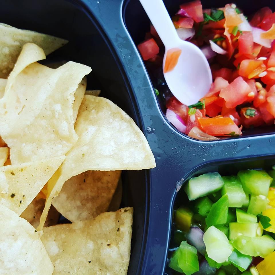 Top right Urban Garden salsa, Bottom right Margarita salsa with original tortilla chips.