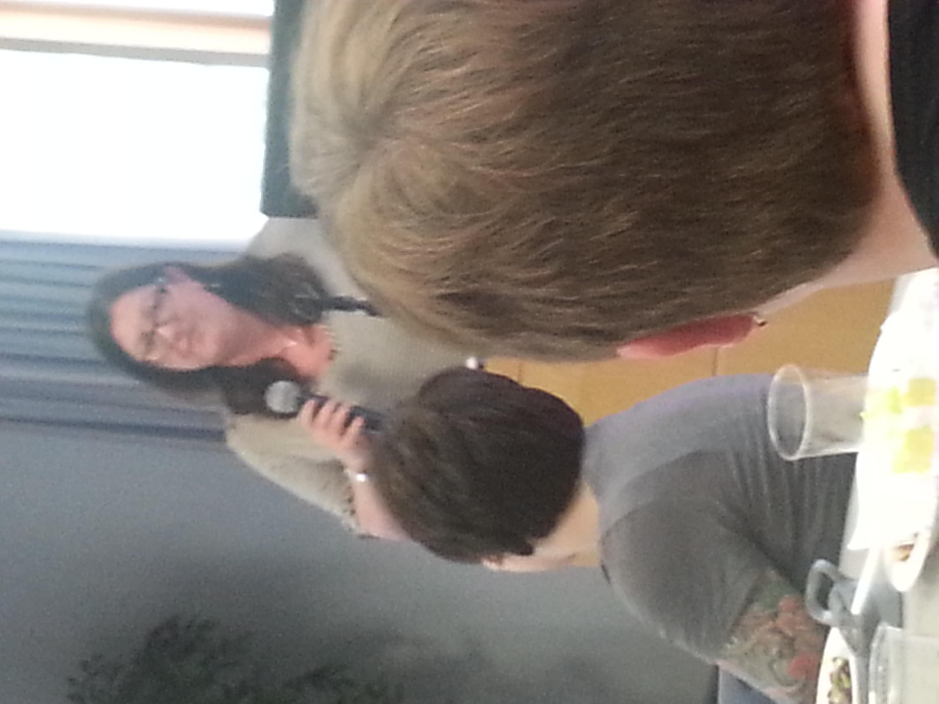 Deb Gussman giving an award.