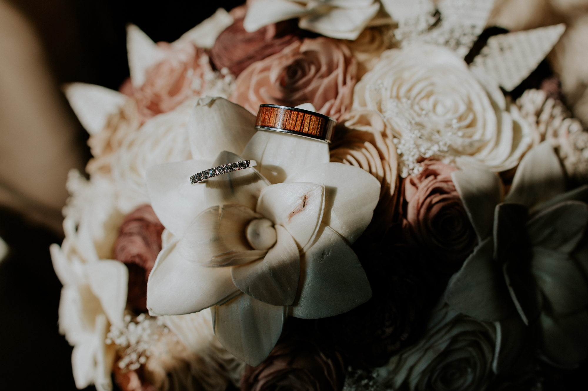 wedding-day-rings-photography-with-wood-flowers