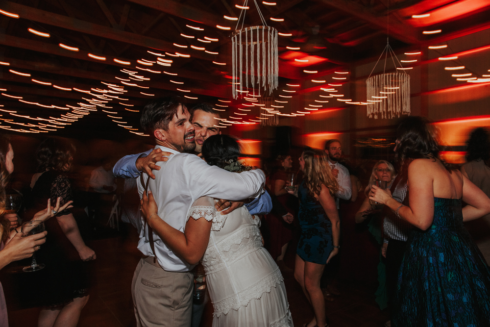 Combined with flash, intentionally using a lower shutter speed (or your camera's bulb mode) will allow you to add some light dragging flare to your reception dancing photos!