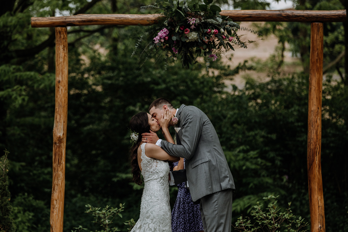 barn-swallow-farm-lehigh-valley-wedding-photography-ceremony-first-kiss