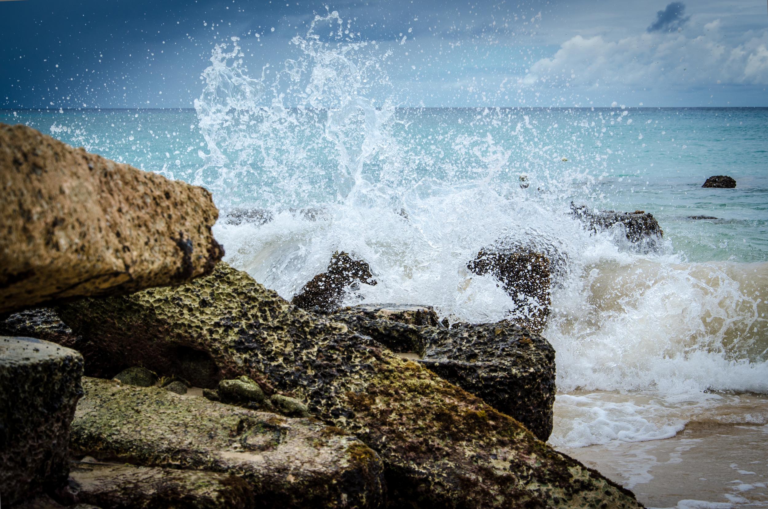 Waves on the rocks at the Fairmont Royal Pavilion Resort.