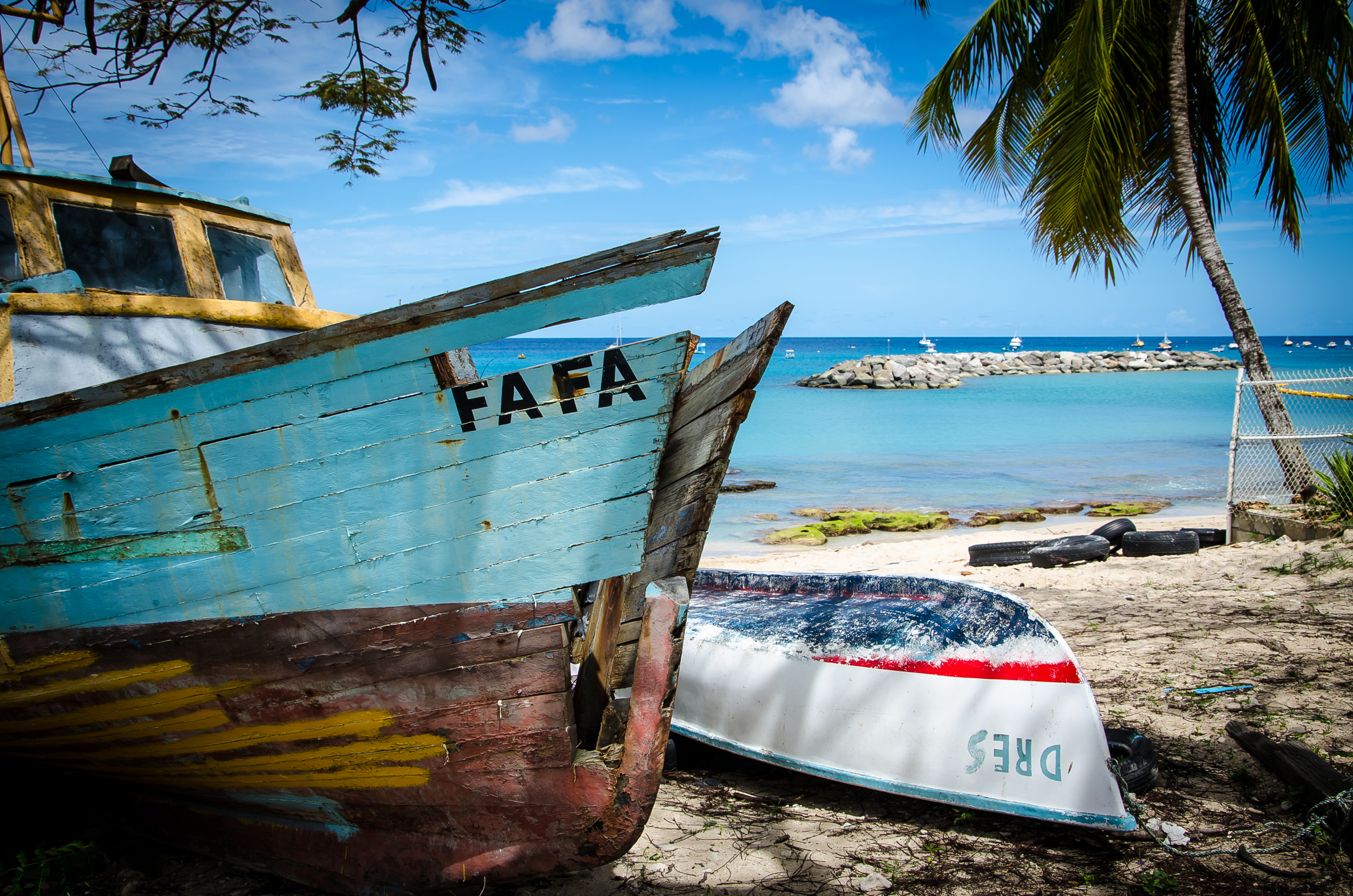 Old Fishing boats on the shore.