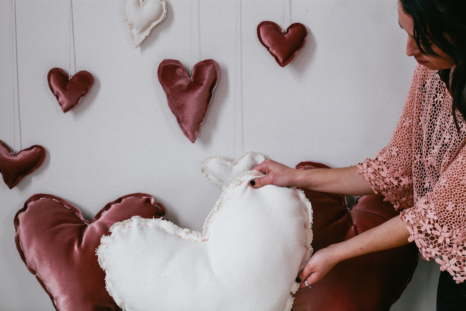 woman holding cute valentine diy pillows holiday