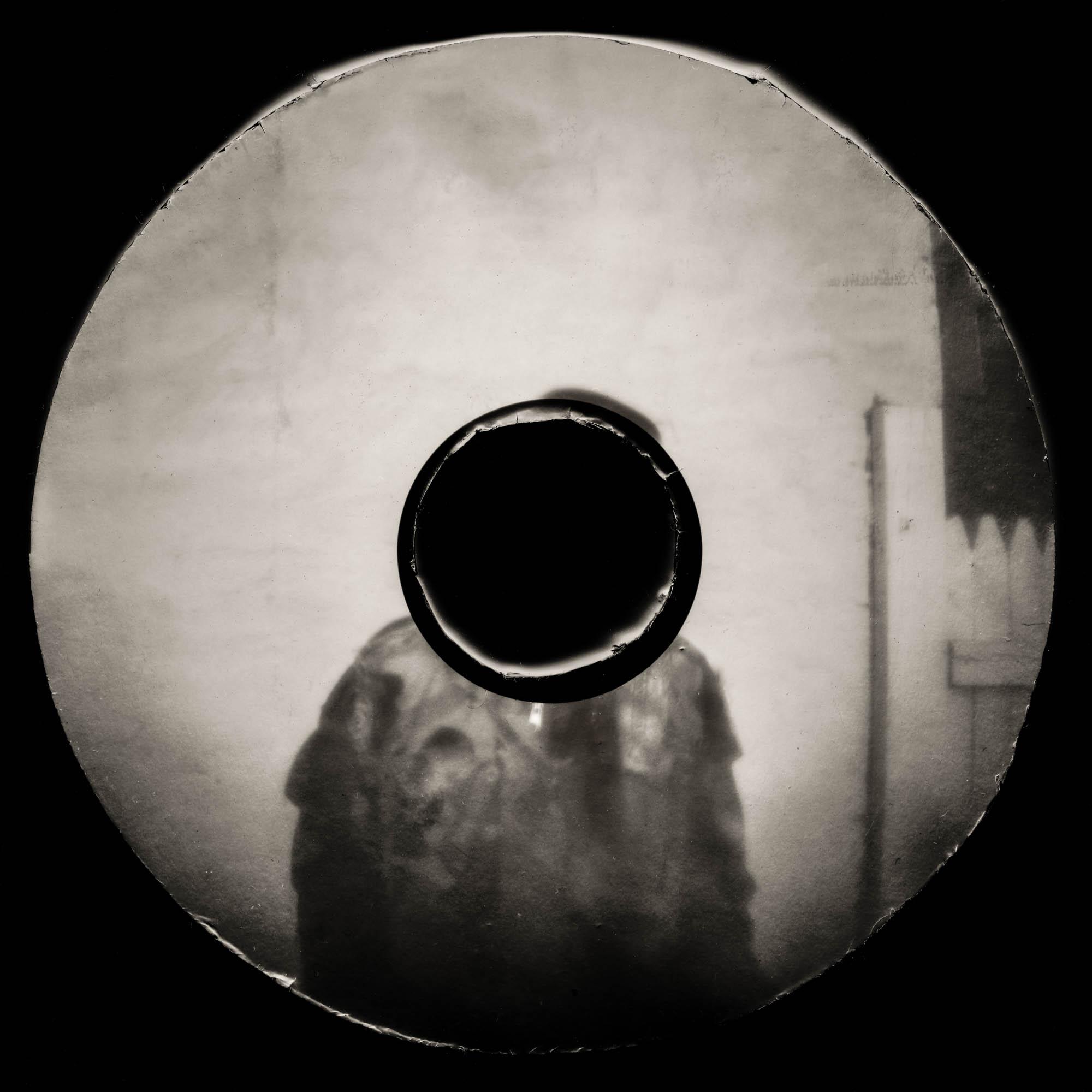 Black and white paper pin hole hard drive camera