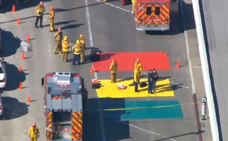 Fire and rescue personnel gather at Los Angeles International Airport on Friday.(Associated Press via CBC)