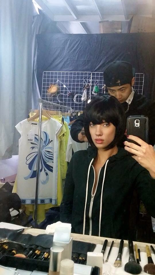 Erin on set in Shanghai with what was one of many clothing racks