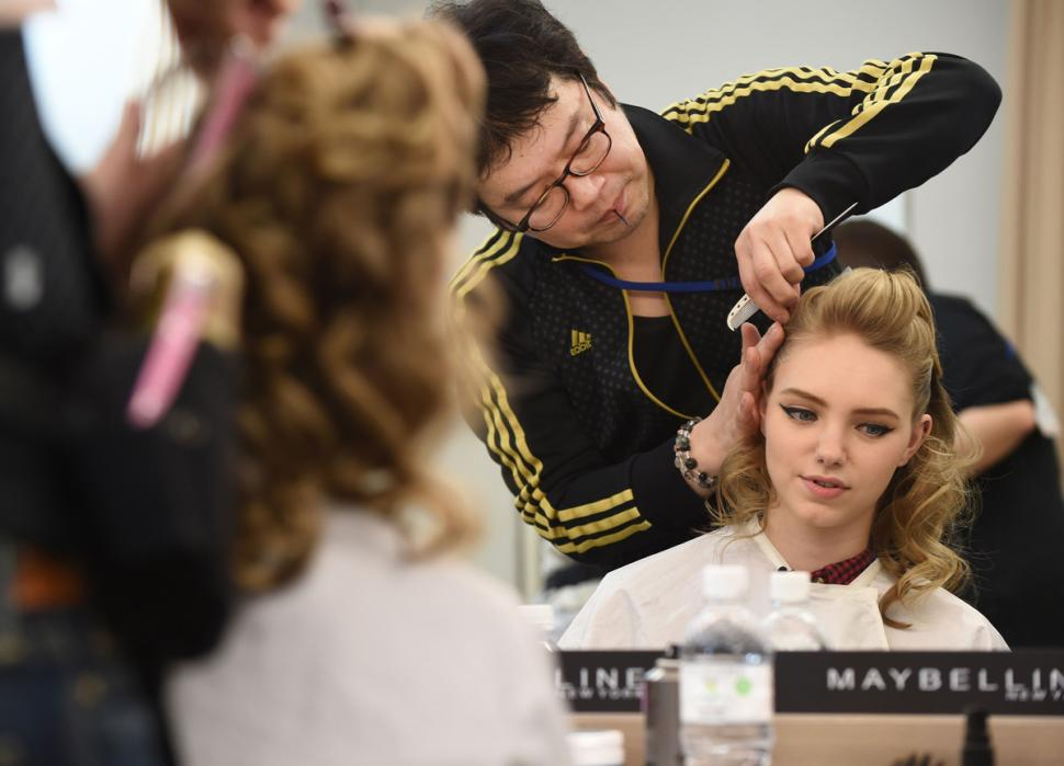 MUA Ko Saito works with Kali Myronenko during Tokyo Fashion Week |  Toru Yamanaka/AFP/Getty Images