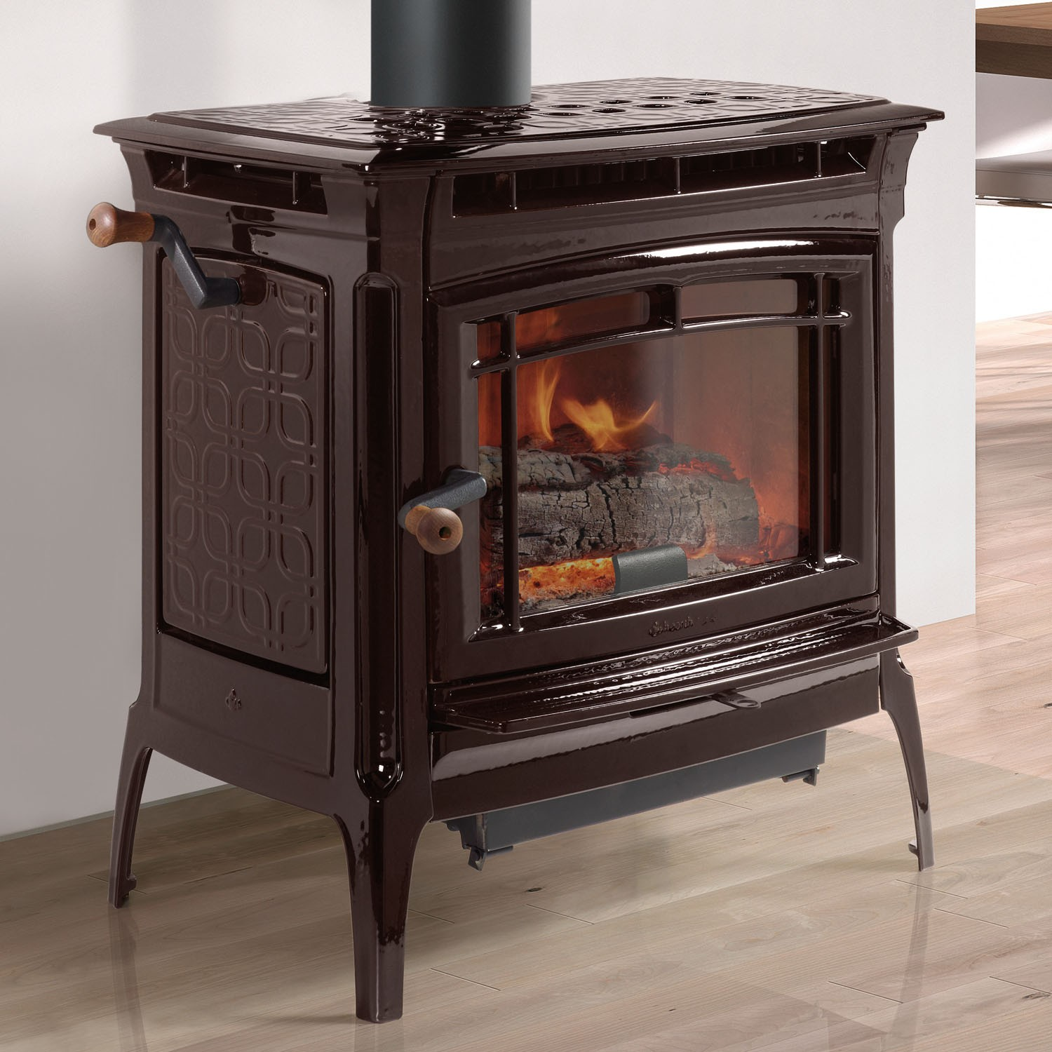 Hearthstone Manchester wood stove; shown in Majolica Brown enamel finish.  The Manchester is  part of the cast-iron line from Hearthstone. It is impressively powerful and has an inner soapstone lining for greater heatlife. It also features a double top as part of its convection system.