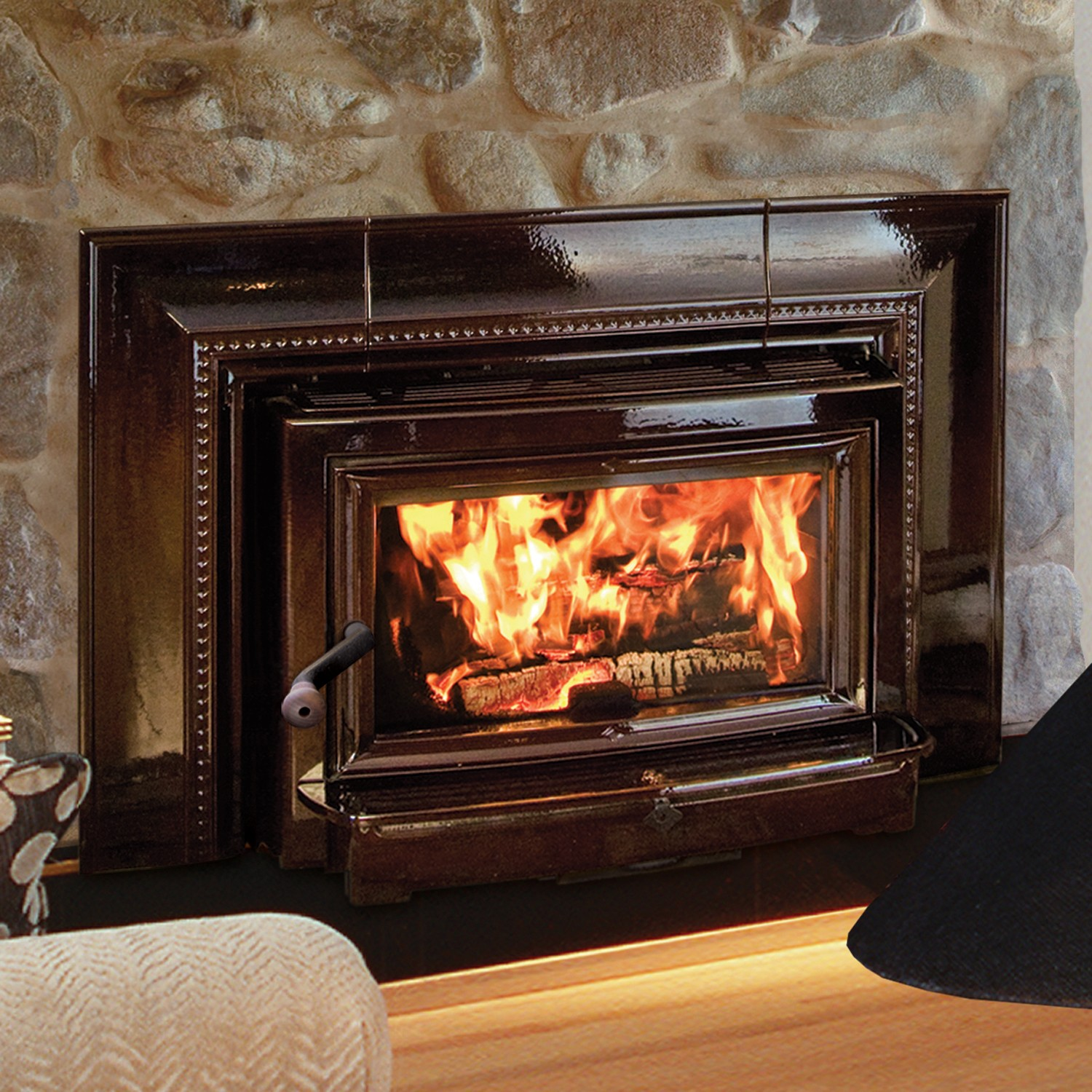 Hearthstone Cldesdale wood burning fireplace insert. Expansive glass, unobstructed view, high power, soapstone-lined, all cast-iron...  numerous virtues for a fireplace insert.  It also features adjustable depth.  Blower and standard panel included.