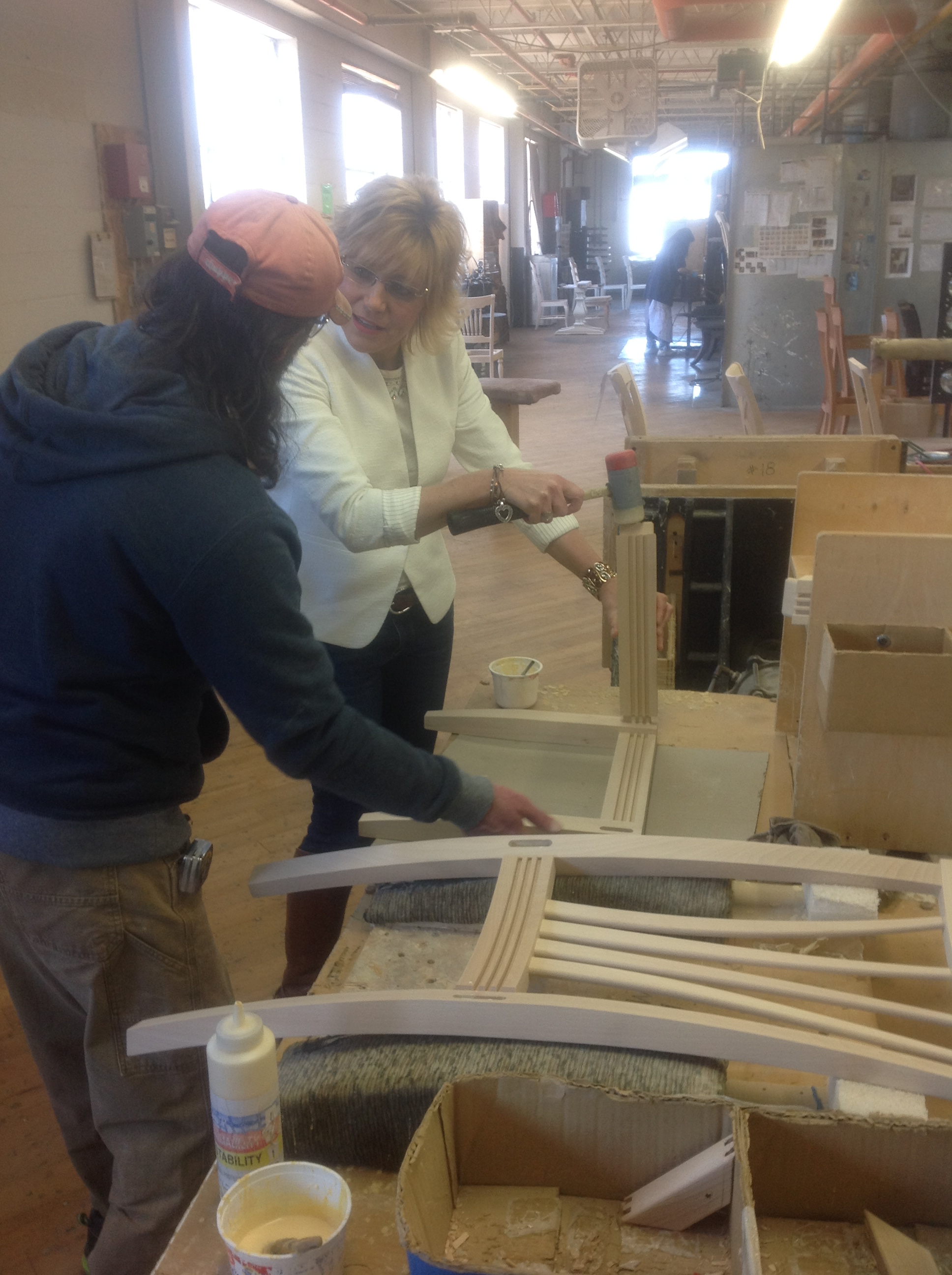 Our own Tammy K. is given instruction on chair assembly during a recent factory tour. Come meet Tammy in our showroom. She has a knack for design you'll appreciate!