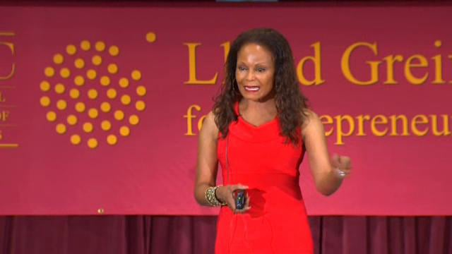 Janice Bryant Howroyd is an entrepreneur and her company is worth over $1 billion. That's with a B, ya'll. She is founder and chief executive officer of ACT-1 Group, the largest minority woman-owned employment agency in the United States. Showcasing your arms, and wearing the color red, is usually frowned upon at business events. Janice demonstrates how you can remain classy while exuding feminity.
