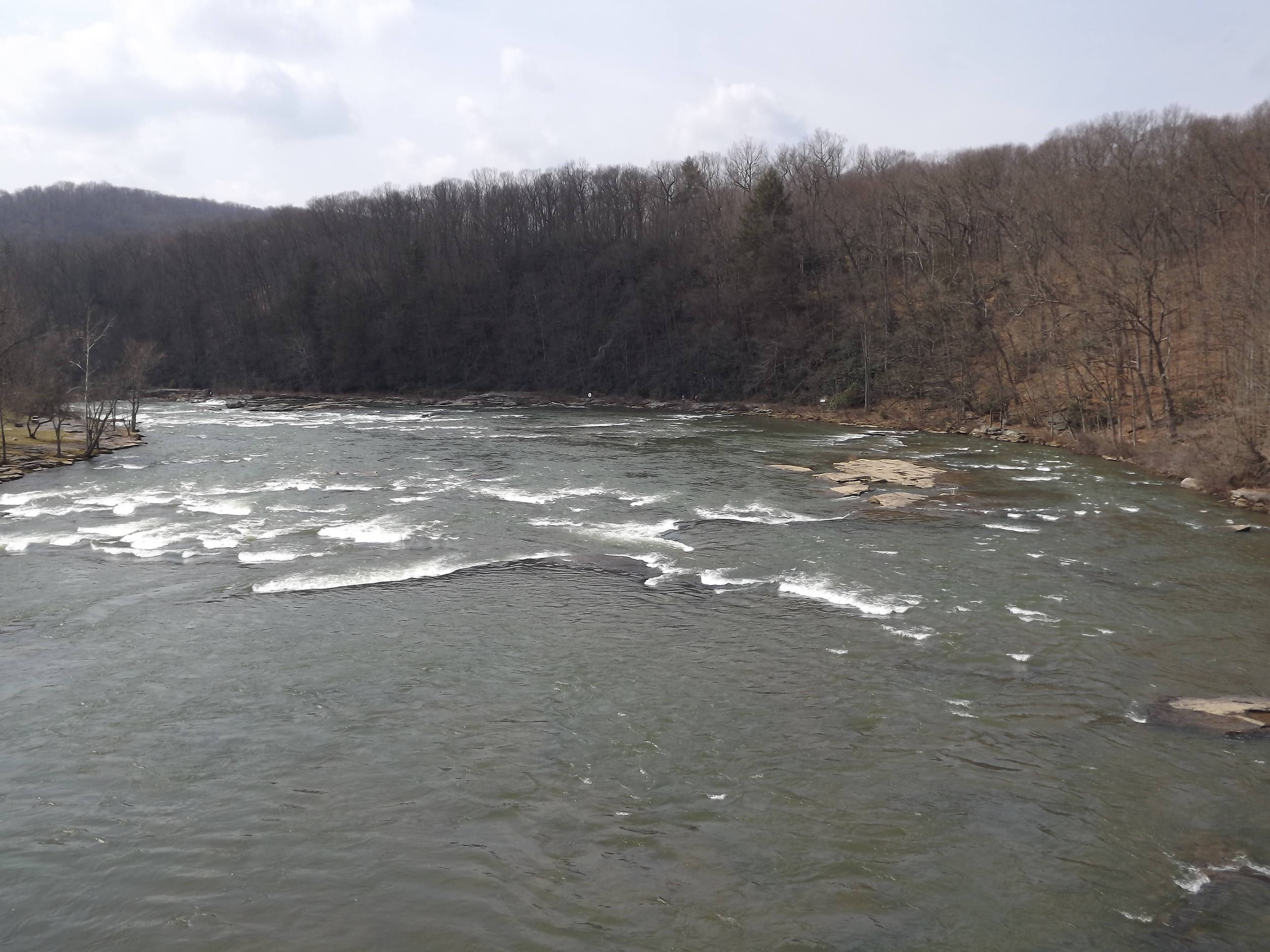 I took this picture while standing on the bike/walking bridge on the Ohiopyle side of the Ferncliff peninsula. This section of the river is directly above the main falls, which are about 100 yards around the bend downriver in the photo.