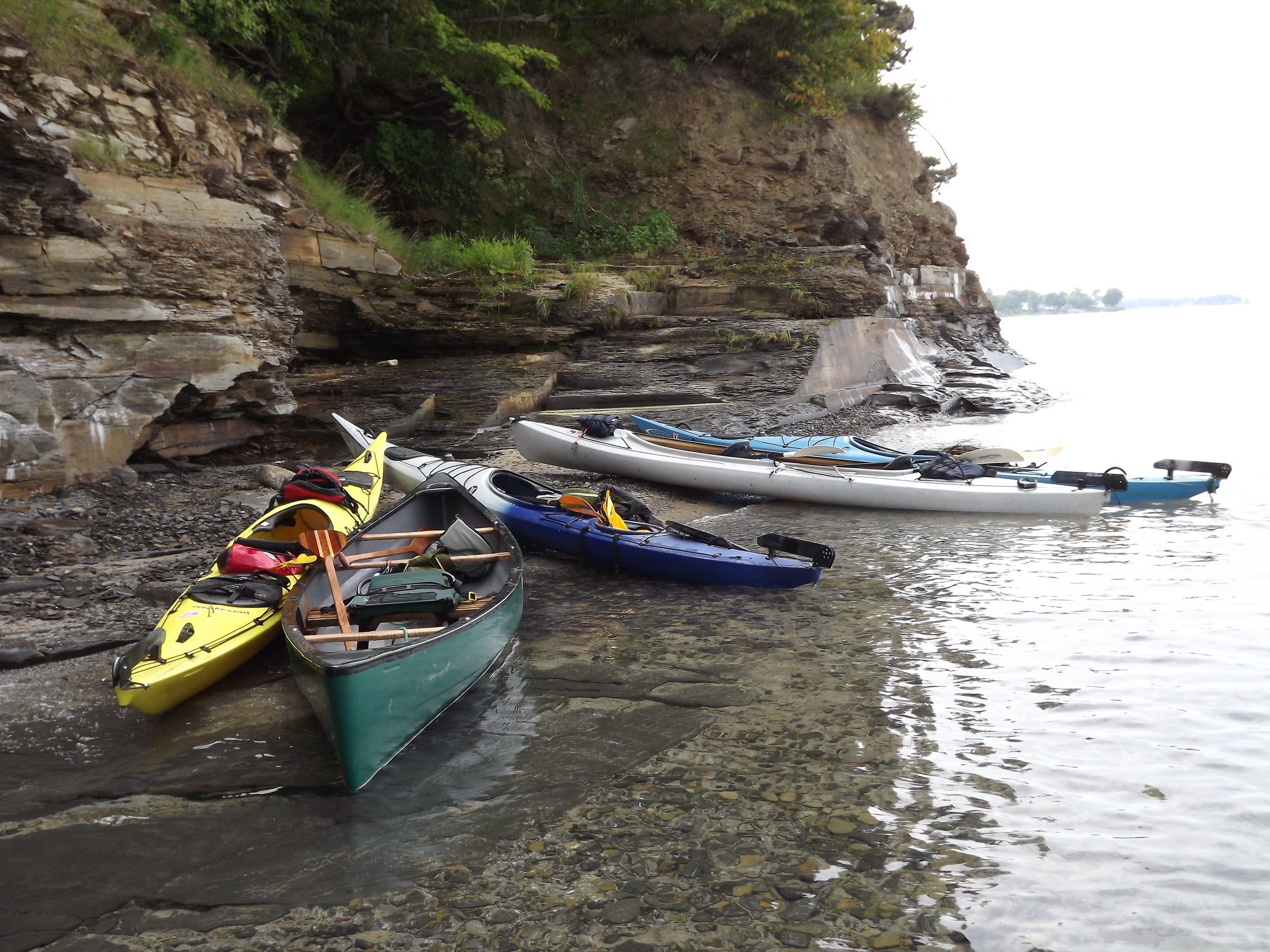 My canoe and our kayaks all pulled up to shore near a small waterfall that is about a mile or so down the beach from my sisters' house on Lake Erie.