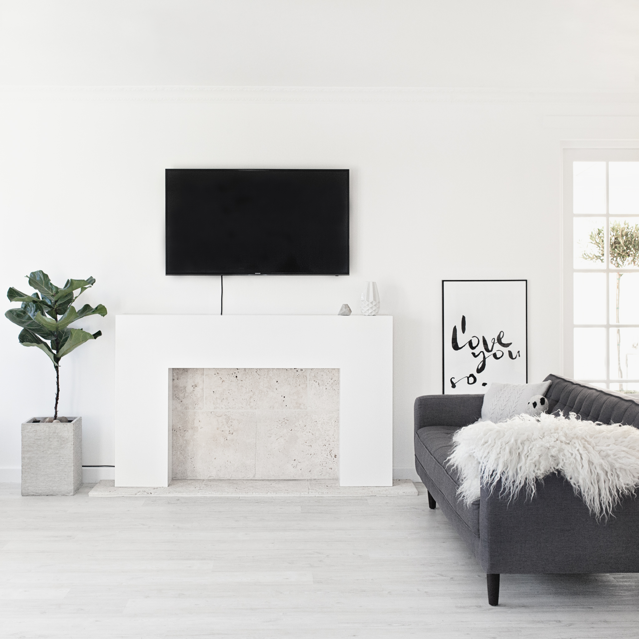 White Icelandic Sheepskin Rug from   Milabert  | 'I Love You So.' Poster from   Olive et Oriel