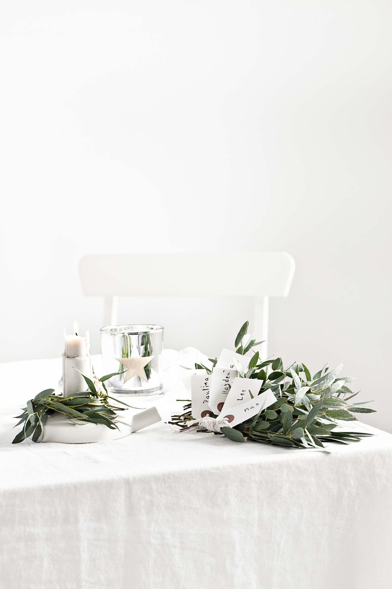 Star 'Holly Berry' scented candle from   Lovely Pair   | White   Serax   ceramic candle holder from   istome