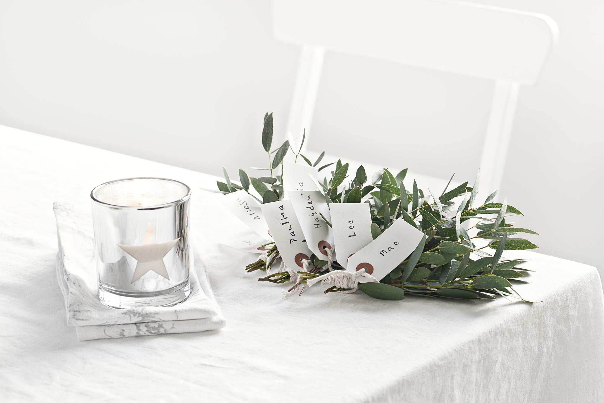 Star 'Holly Berry' scented candle from   Lovely Pair    | Table cloth and napkins from  The White Company