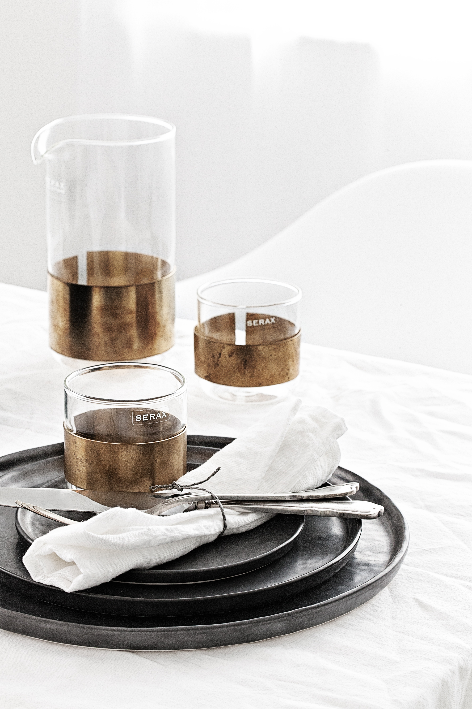 Black Ceramics Tableware   by  Pascale Naessens  |   Copper Glass Carafe Set   by  Niels Datema  | All from   Serax Belgium