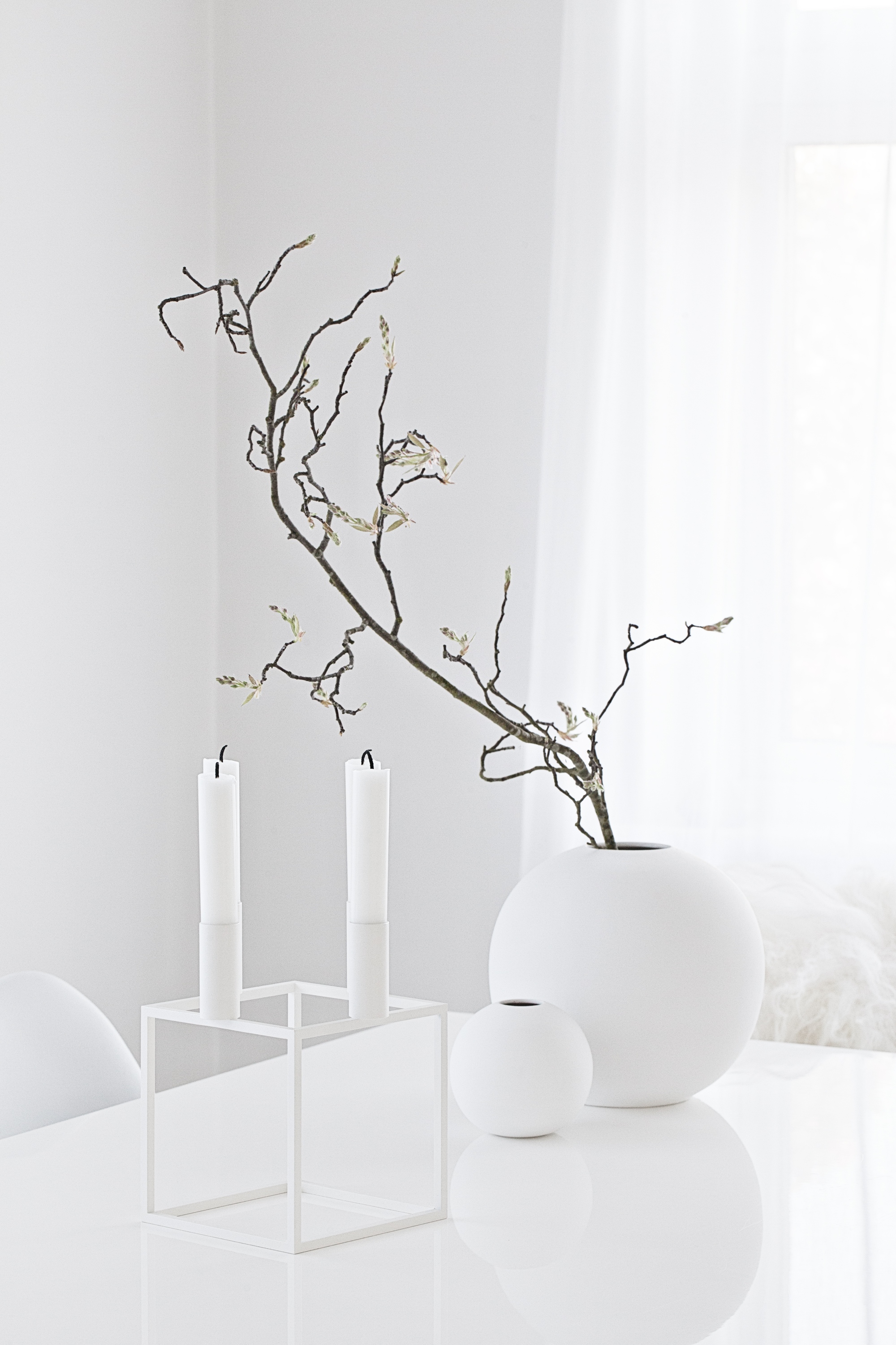 White Kubus 4 Candle Holder from  Made Modern  | White Round Vases from  Cooee  and for all the UK fans, they will soon be available from Made Modern!