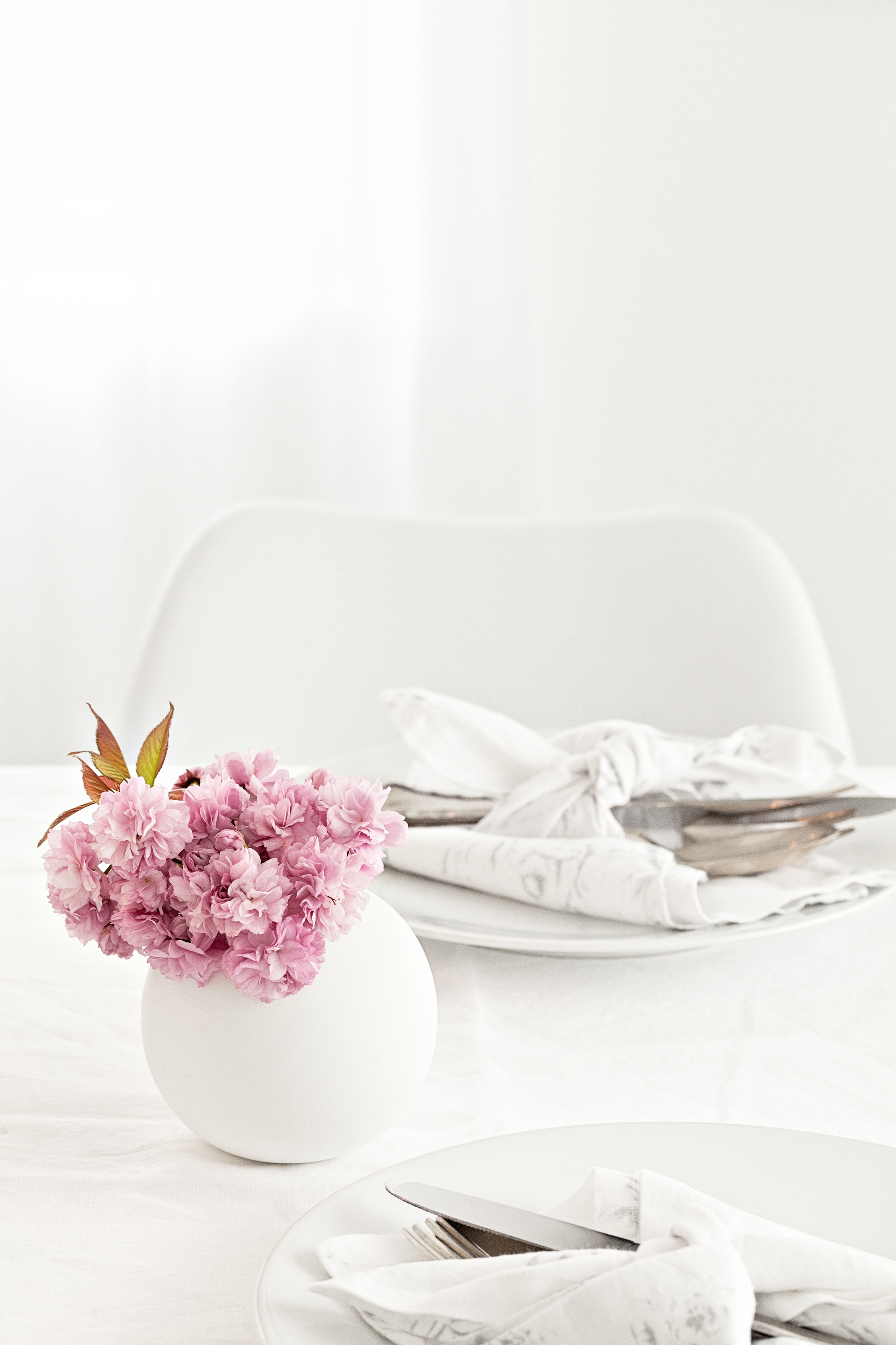 White round vase from   Cooee   | Table linens from   The White Company
