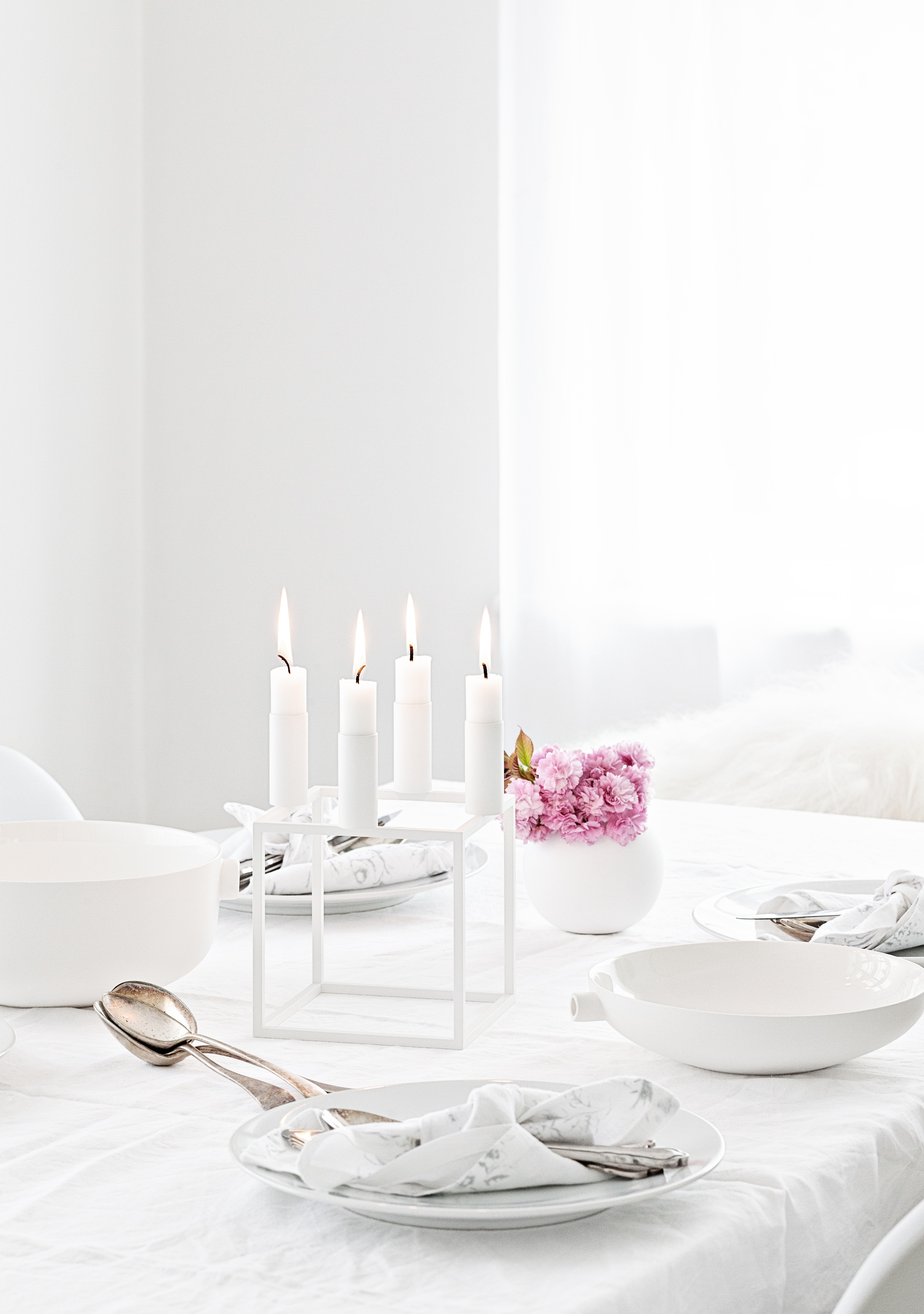White round vase from  Cooee  | Table linens from  The White Company  | White By Lassen Kubus 4 Candle Holder from   Made Modern