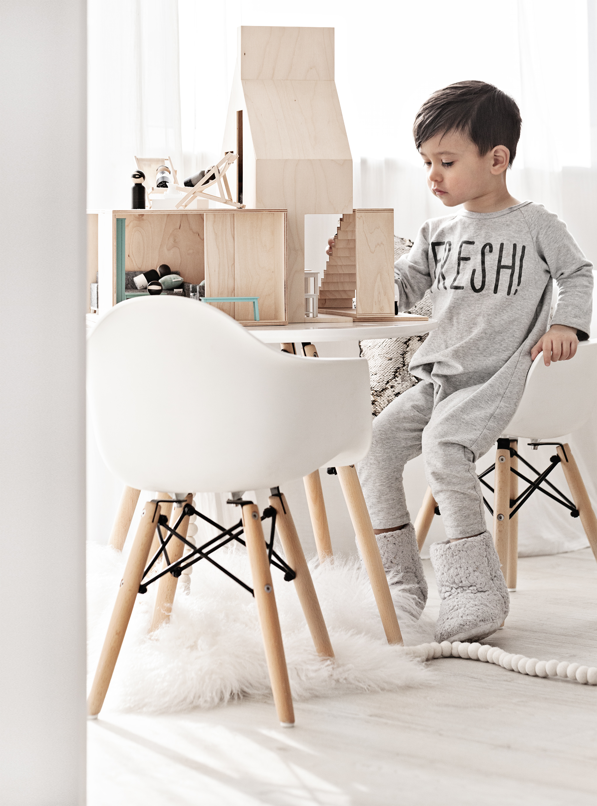 Dollhouse & Furnitures from   Boomini Dollhouse   | White Mongolian Sheepskin Rug from   Milabert  |   Jumpsuit from   Little Urban Apparel  | Peg Dolls from   Made by Layla