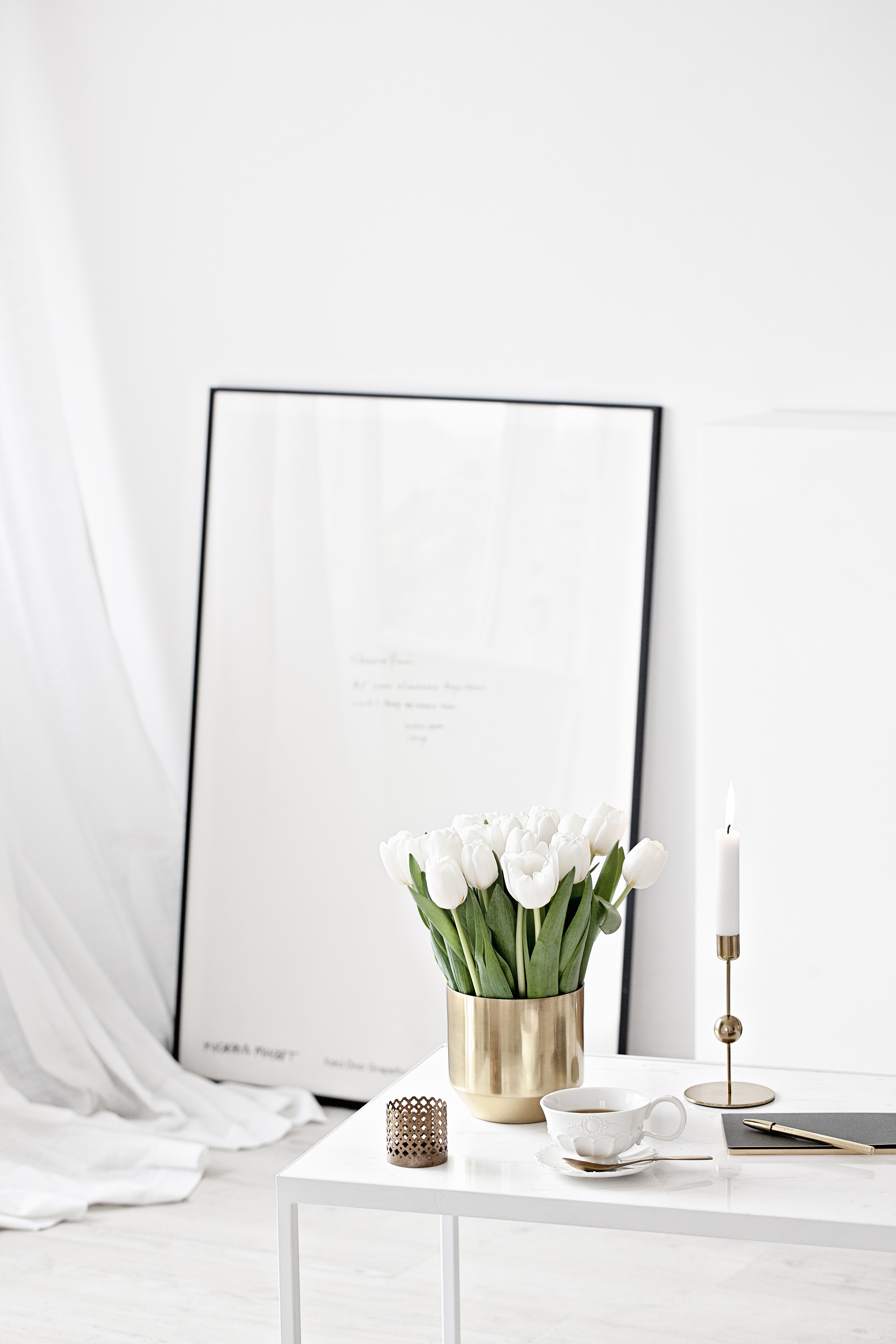 Gold & Brass Vase, Candle Holders from H&M | Gold Note Pad & Gold Pen from Hay Design | White Tulips | Yoko Ono Poster Print | White Marble Table from Serax Belgium