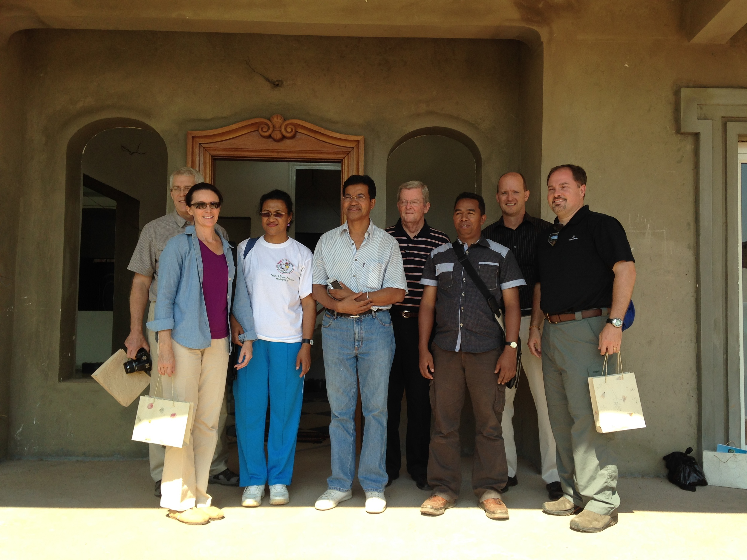 Malanto and husband Lanto (third & fourth from left) shared their vision to use this building of theirs as the first Christian Credit Union in Madagascar.