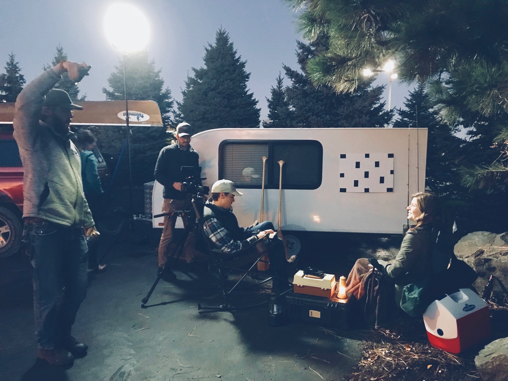 Behind the scenes look at our urban campsite. Light positioned to simulate the moon and our actors dutifully imagining a projection on the trailer.